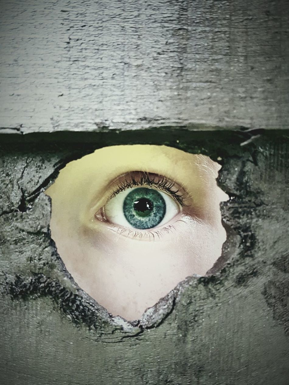 Thinks100 day 35. Intrigue Eye Looking Through Hole Hole In Fence