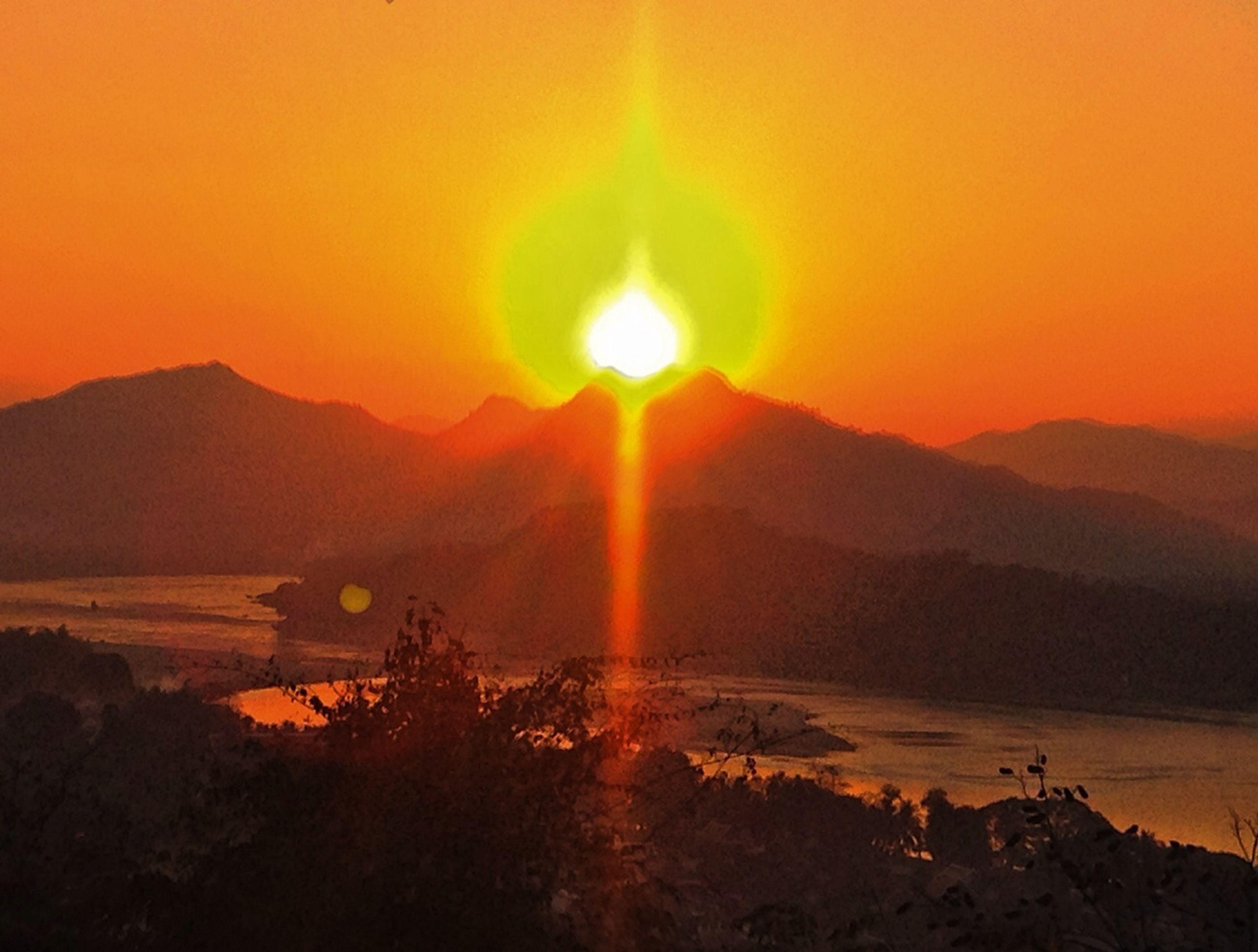 sunset, sun, mountain, tranquil scene, scenics, tranquility, orange color, beauty in nature, silhouette, sunlight, mountain range, idyllic, landscape, nature, sunbeam, sky, lens flare, non-urban scene, remote, outdoors