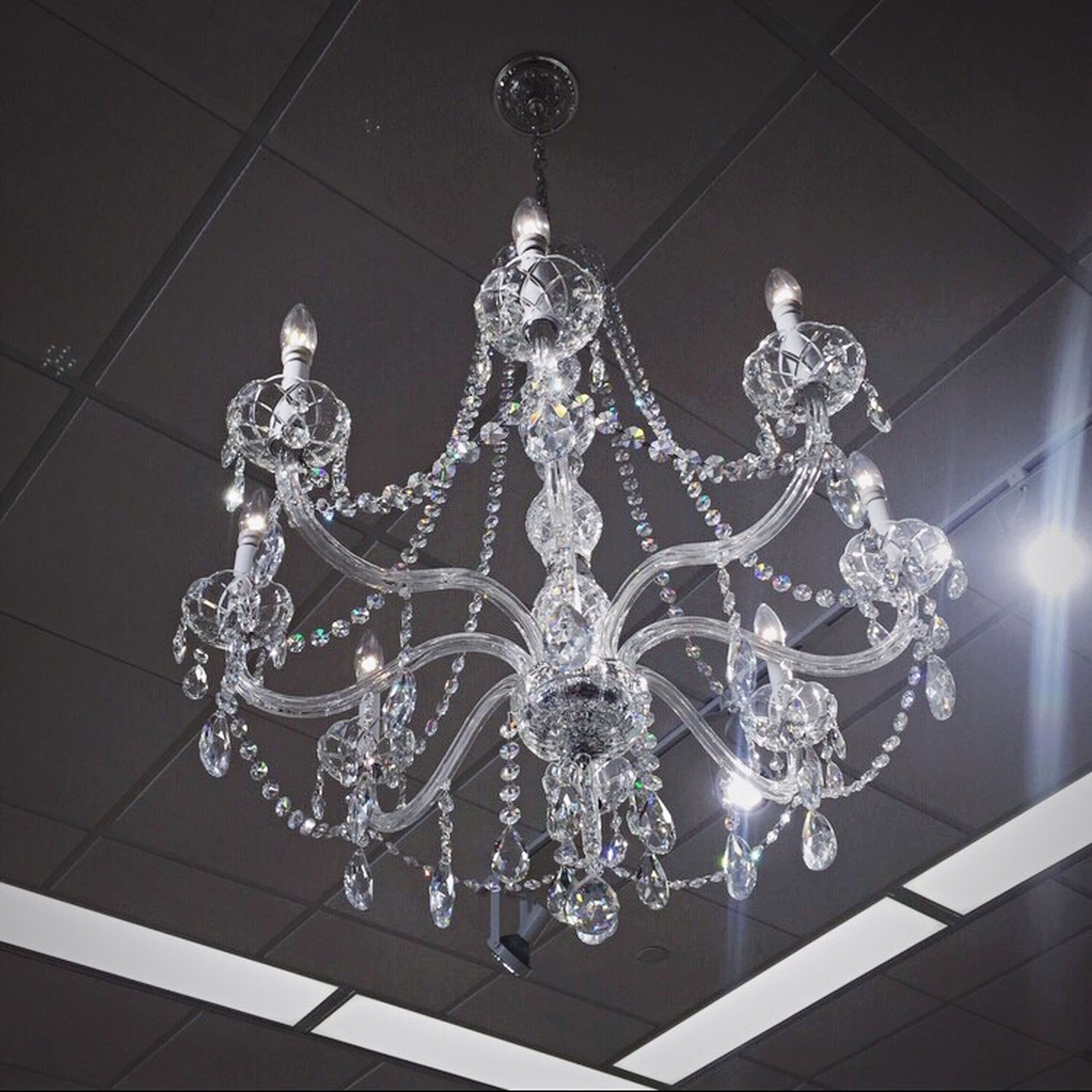 indoors, hanging, low angle view, decoration, ceiling, illuminated, lighting equipment, art and craft, chandelier, art, electricity, creativity, ornate, human representation, no people, decor, design, wall - building feature, reflection