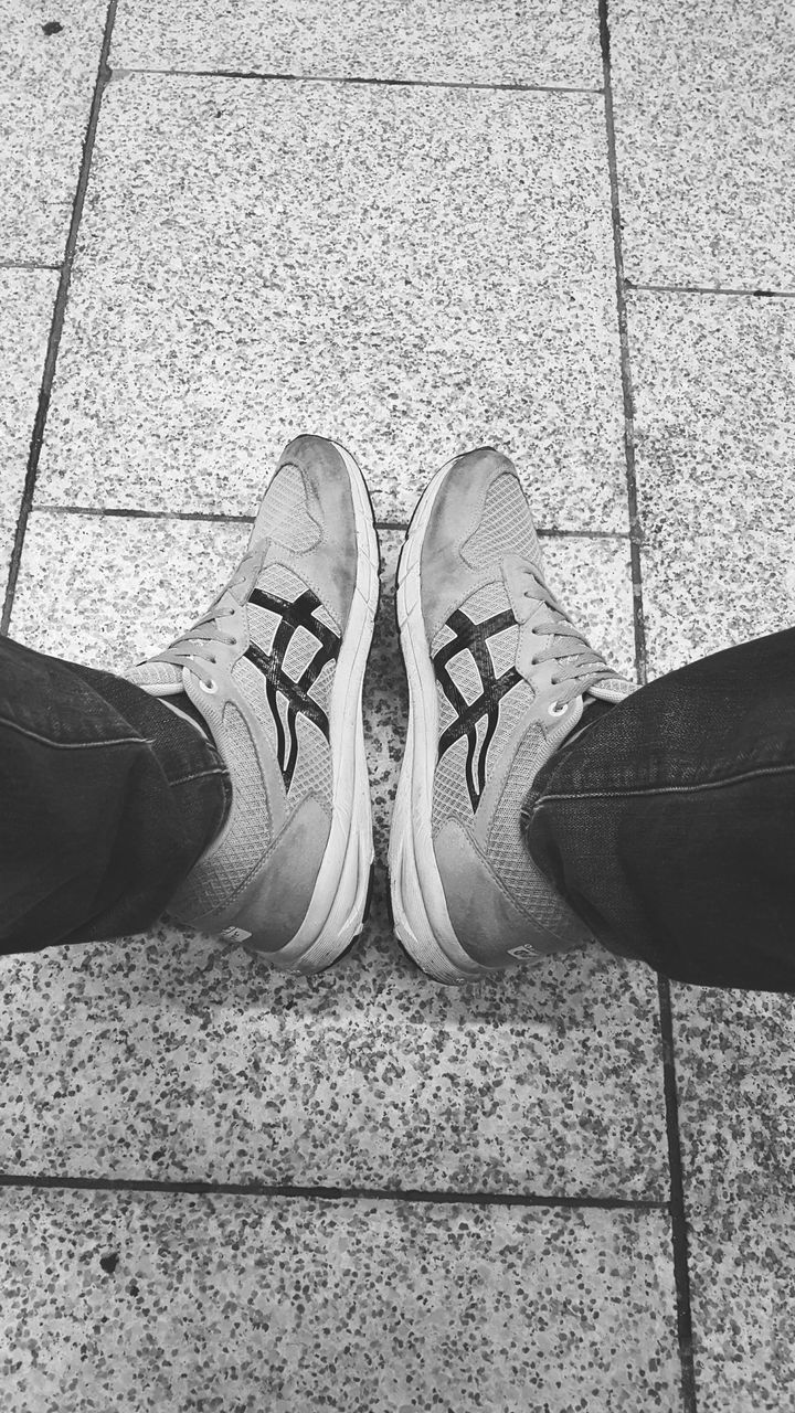 shoe, human leg, low section, standing, human body part, personal perspective, real people, high angle view, men, human foot, canvas shoe, pair, day, lifestyles, outdoors, only men, adult, people