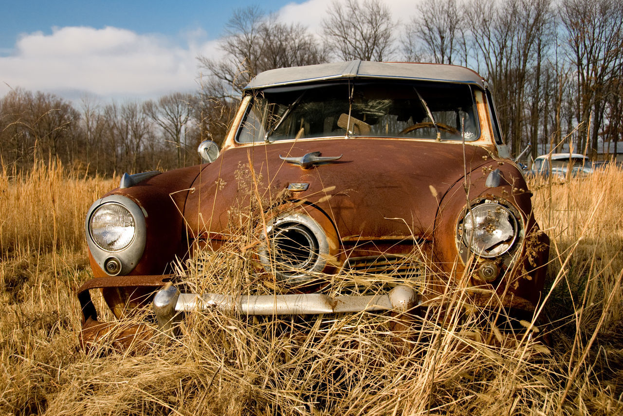 Abandoned Abandoned Car Damaged Day Field Grass Hay Land Vehicle Landscape Mode Of Transport No People Obsolete Old Outdoors Rural Scene Rusty Sky Tractor Transportation Tree