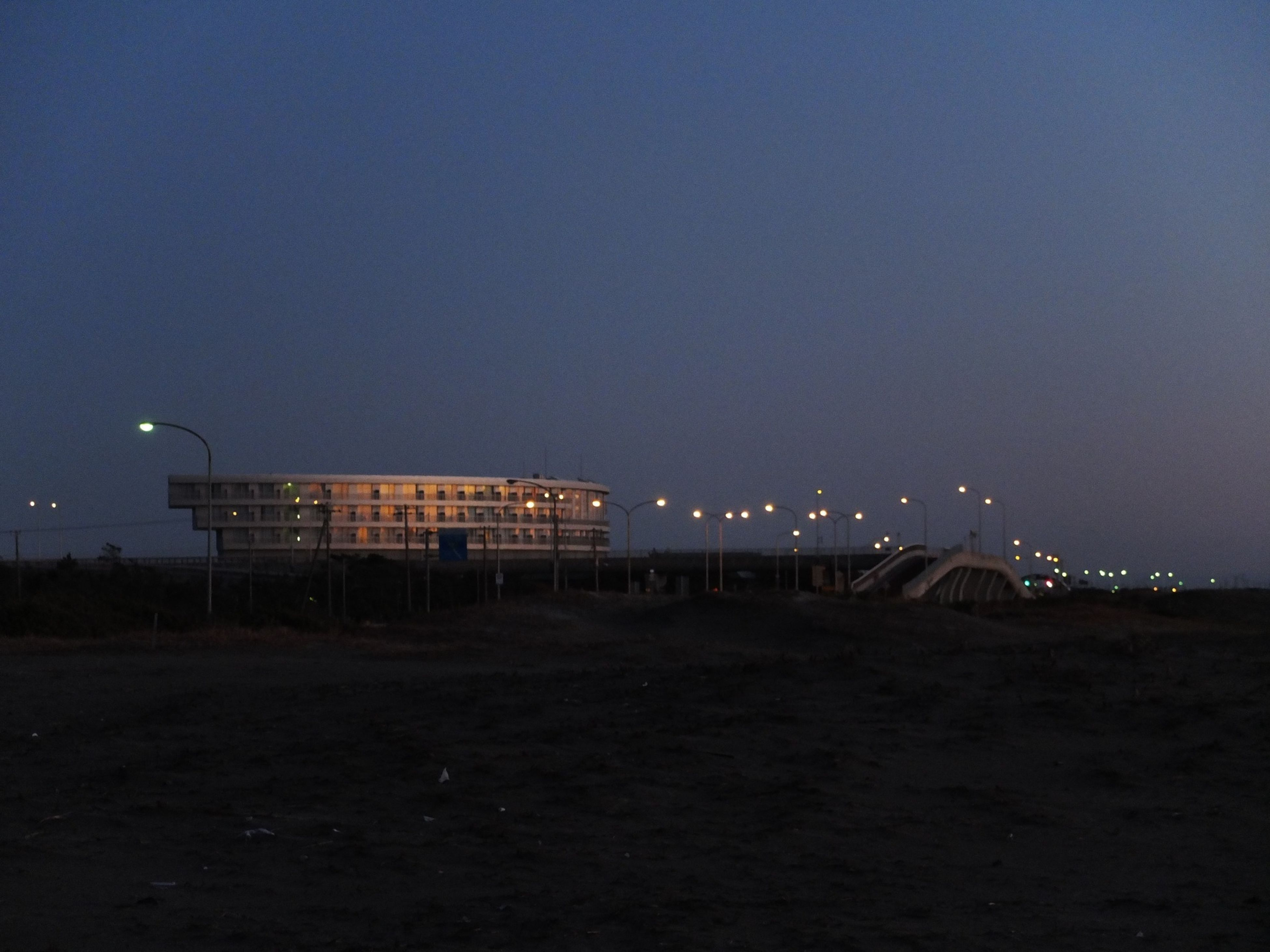 night, illuminated, architecture, built structure, copy space, sky, building exterior, clear sky, dusk, outdoors, no people, tranquility, dark, nature, landscape, city, beach, lighting equipment, scenics, tranquil scene