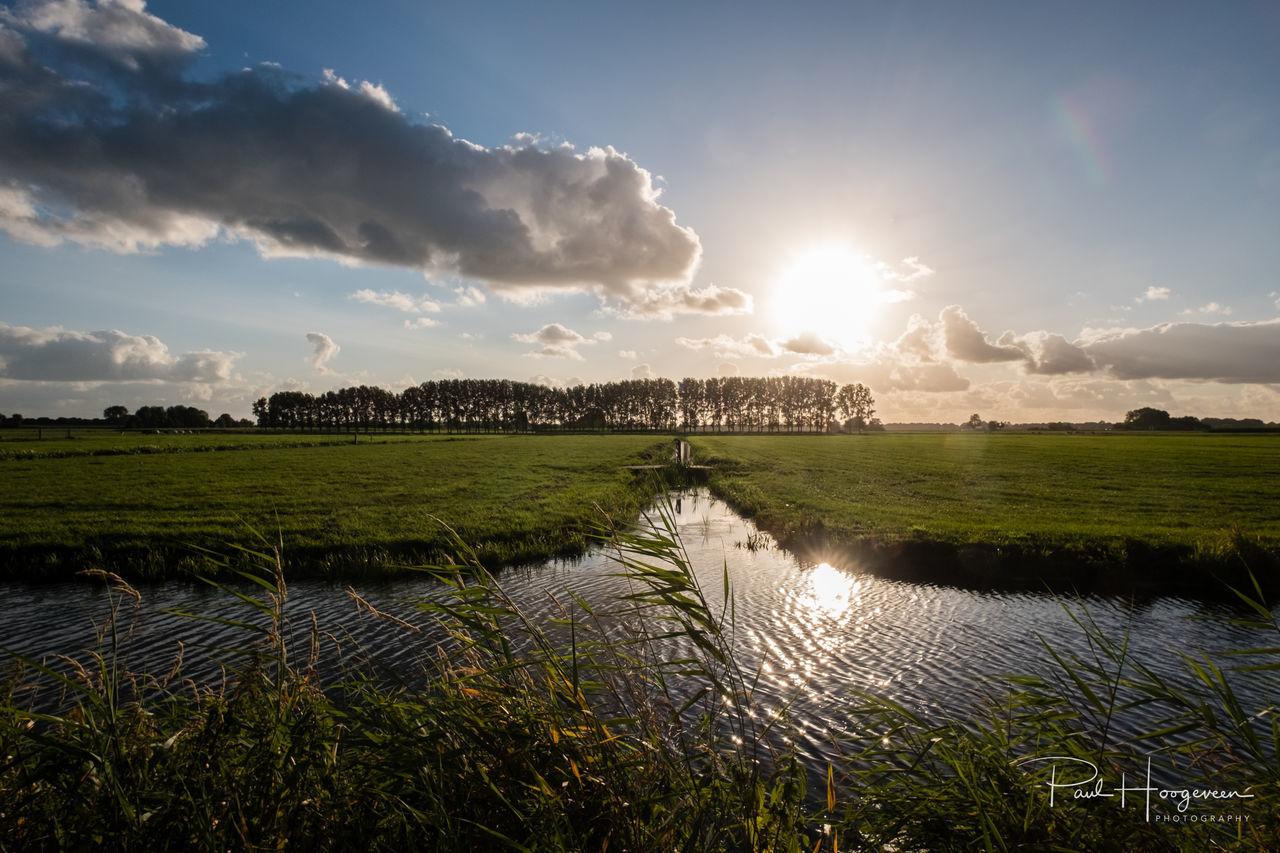 Mijdrecht polder Beauty In Nature Cloud - Sky Clouds And Sky Day Farmland Field Grass Growth Holland Landscape Mijdrecht Nature Netherlands No People Outdoors Scenics Sky Sunlight Tranquil Scene Tranquility Water
