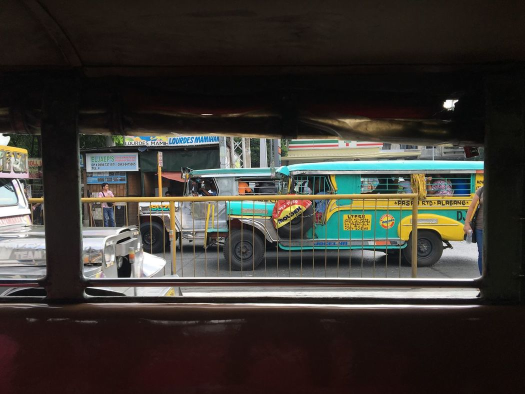 Public tranports called jeepneys cruise along a busy road in Metropolitan Manila Philippines. Manila, Philippines Jeepney Jeepney Ride Jeepney Art Jeepney Colors Public Transportation Public Transport Transportation Commuters Commute Manila Metropolitan Manila My Commute