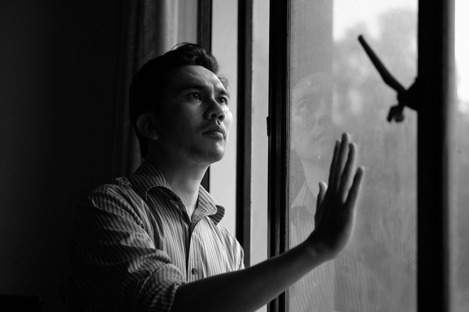 A man standing Real People One Person Window Indoors  Lifestyles Young Adult Headshot Day Young Women Close-up People Monochrome Black And White Blackandwhite Adult Hand Touching Self Portrait Selfportrait Portrait Front View Standing Looking Through Window Indoors  Resist