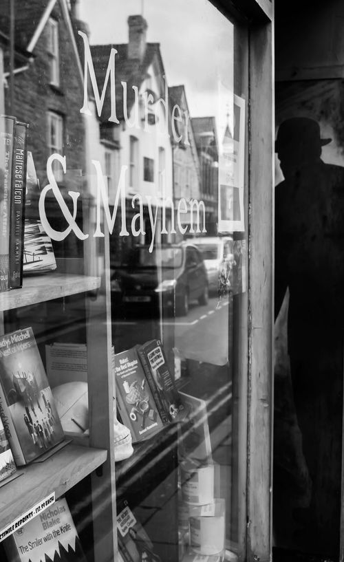 Book shop window and suspicious customer... Black And White Photography Bookstore Building No People Outdoors Portrait Reflections And Shadows Shop Front Window Reflections Window Shopping