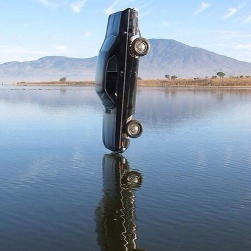 Amazing Photo 1 Second unbeliveable moment car wrecked water blue sky
