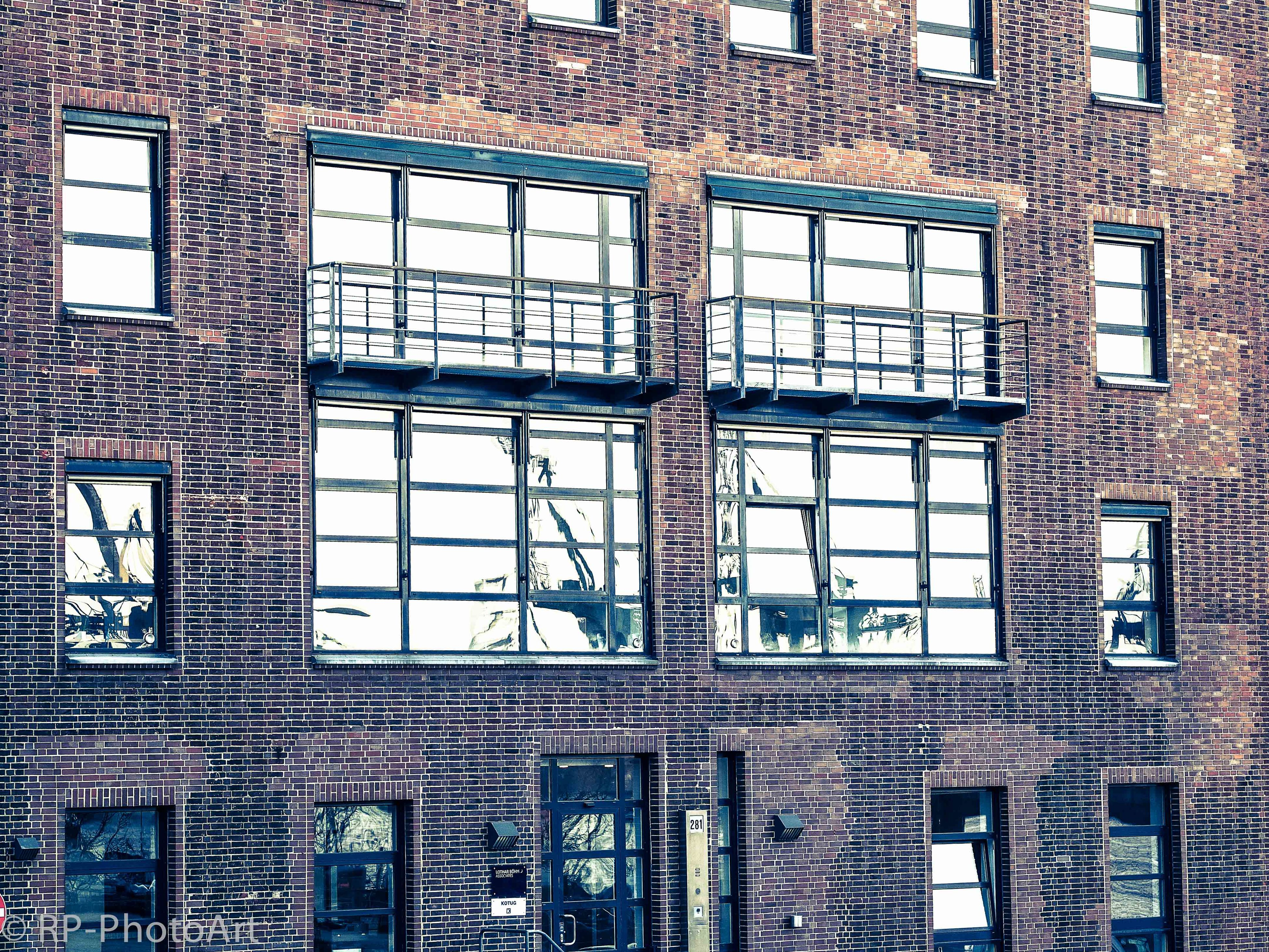 architecture, window, built structure, building exterior, full frame, backgrounds, glass - material, building, low angle view, pattern, residential building, residential structure, day, reflection, no people, city, brick wall, wall - building feature, outdoors, wall