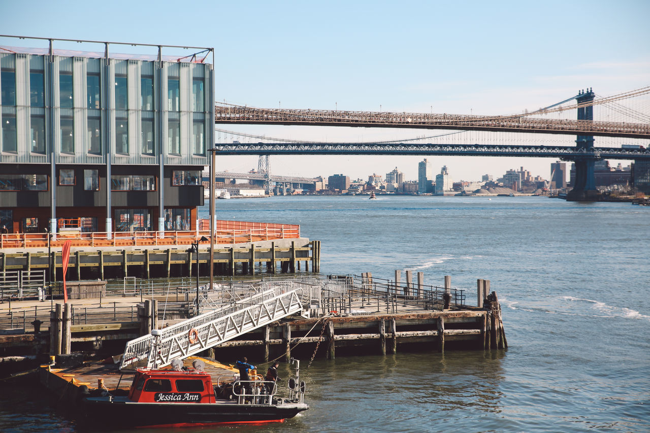 bridge - man made structure, transportation, connection, architecture, built structure, water, mode of transport, river, clear sky, day, outdoors, nautical vessel, no people, building exterior, nature, sky