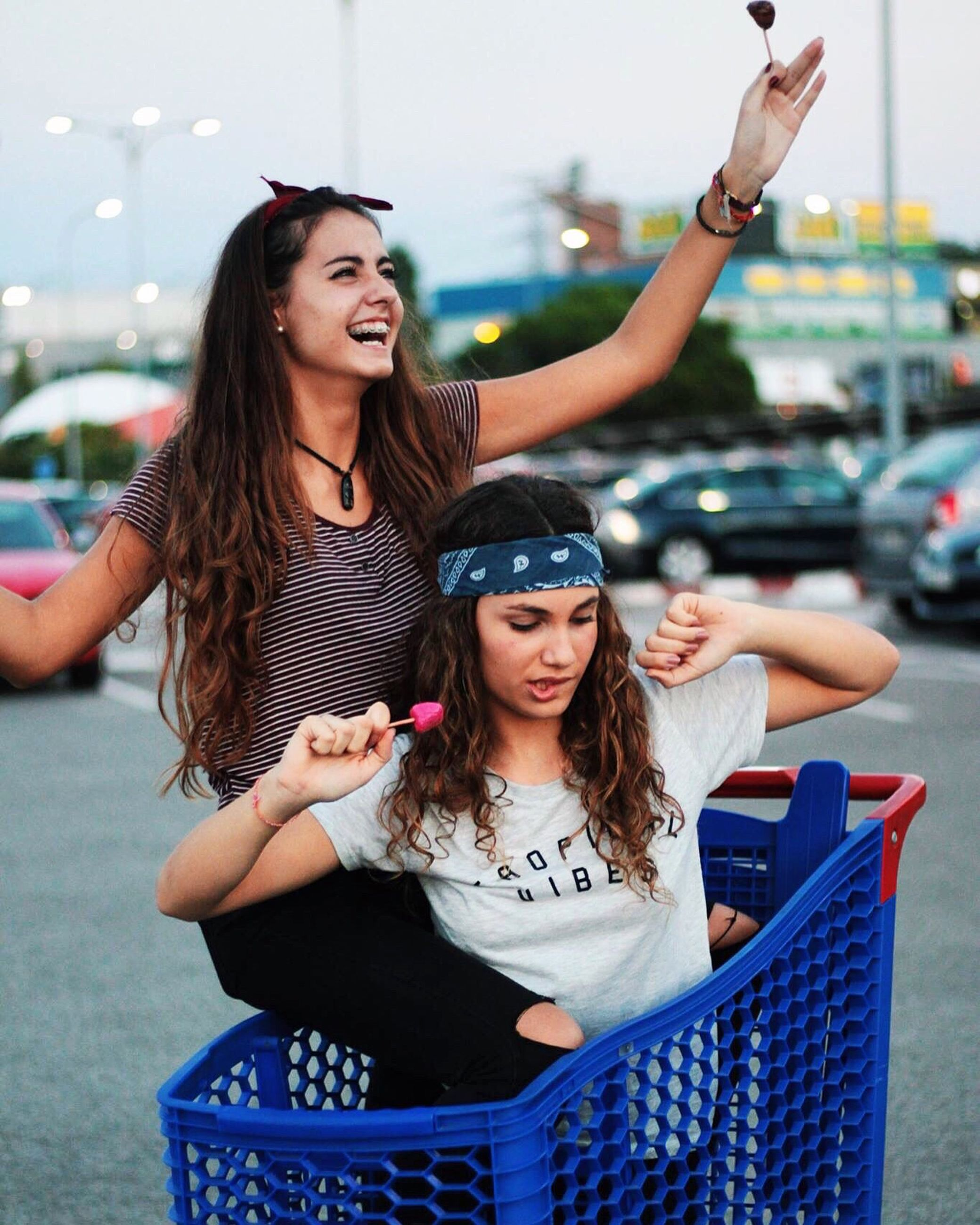 smiling, young women, focus on foreground, happiness, young adult, leisure activity, incidental people, lifestyles, person, long hair, portrait, toothy smile, friendship, looking at camera, casual clothing, cheerful, front view, teenage girls, togetherness, enjoyment, fun, weekend activities, joy, vacations