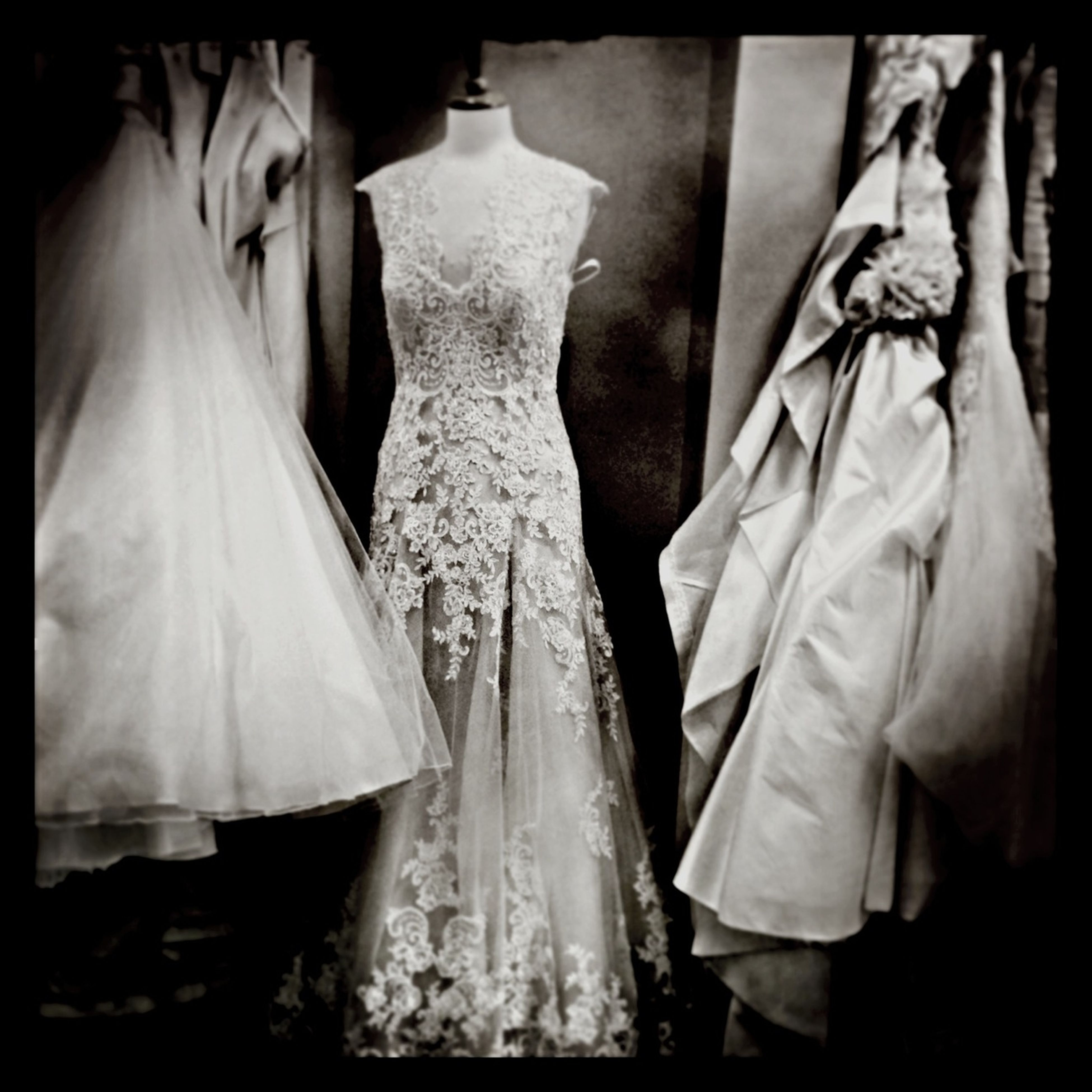 transfer print, indoors, auto post production filter, hanging, clothing, for sale, textile, variation, retail, close-up, mannequin, in a row, panoramic, art and craft, choice, still life, human representation, sale, religion, fabric