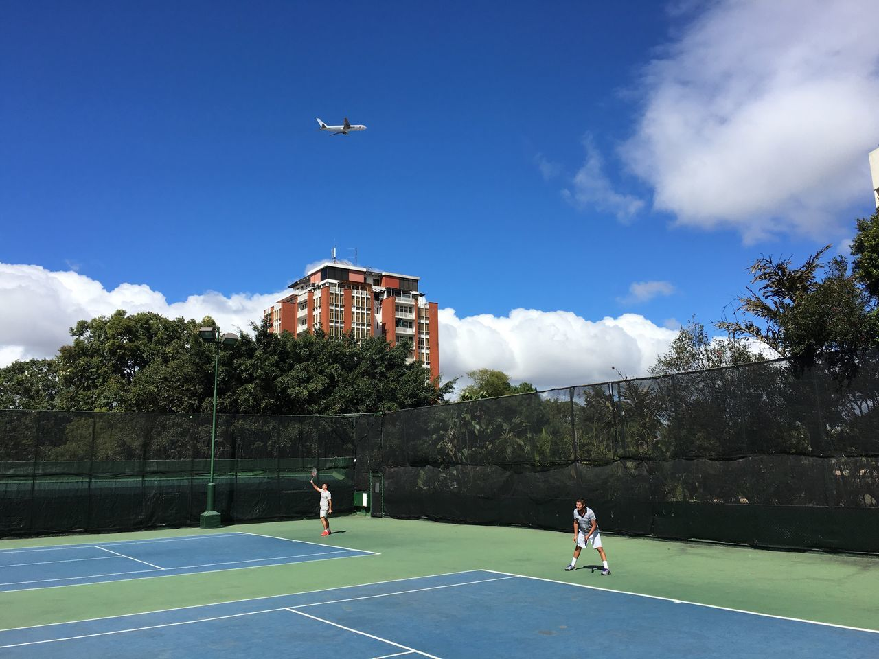 Tenniscourt Flying Transportation Airplane Flying Airplane Playing Tennis Clear Sky Blue Sky