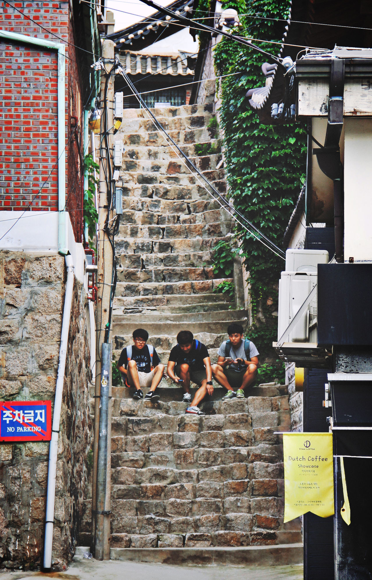 Three Boys Sitting ASIA Boys Day Friends Perched Seoul Sitting South Korea Stairs Steps And Staircases Streetphotography Three Boys, Seoul Travel Showcase April