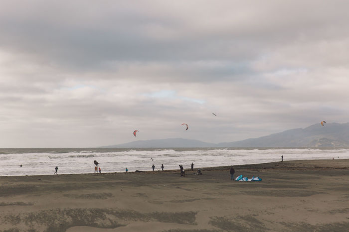 2017 Beach Beauty In Nature Cloud - Sky Day Enjoyment February Flying Horizon Over Water Large Group Of People Leisure Activity Lifestyles Mid-air Nature Outdoors Parachute Real People San Francisco Sand Scenics Sea Sky Sport Vacations Water
