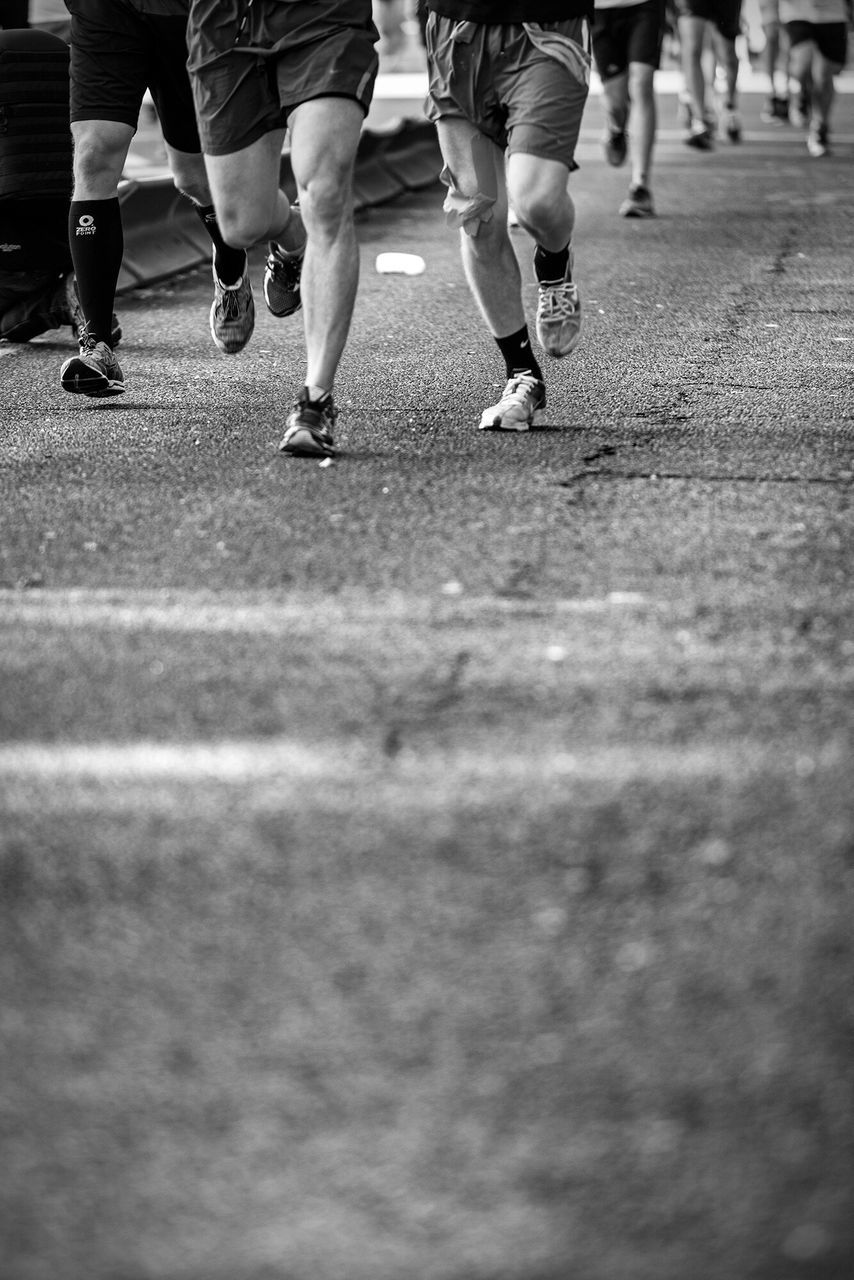 low section, competition, human leg, competitive sport, sport, sports race, real people, lifestyles, men, speed, day, marathon, sportsman, outdoors, athlete, togetherness, challenge, track and field athlete, sports clothing, only men, city, adults only, adult, people