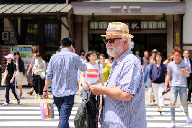 The Street photographies around the Harajuku Station in Tokyo Japan. Architecture Built Structure Casual Clothing City City Life Cool Guy Crowd Cultures Fashionable Focus On Foreground Fujifilm Fujifilm_xseries Large Group Of People Leisure Activity Medium Group Of People Men Mixed Age Range Outdoors Person Tourism Travel Destinations X-PRO2 The Street Photographer - 2016 EyeEm Awards The Portraitist - 2016 EyeEm Awards Natural Light Portrait