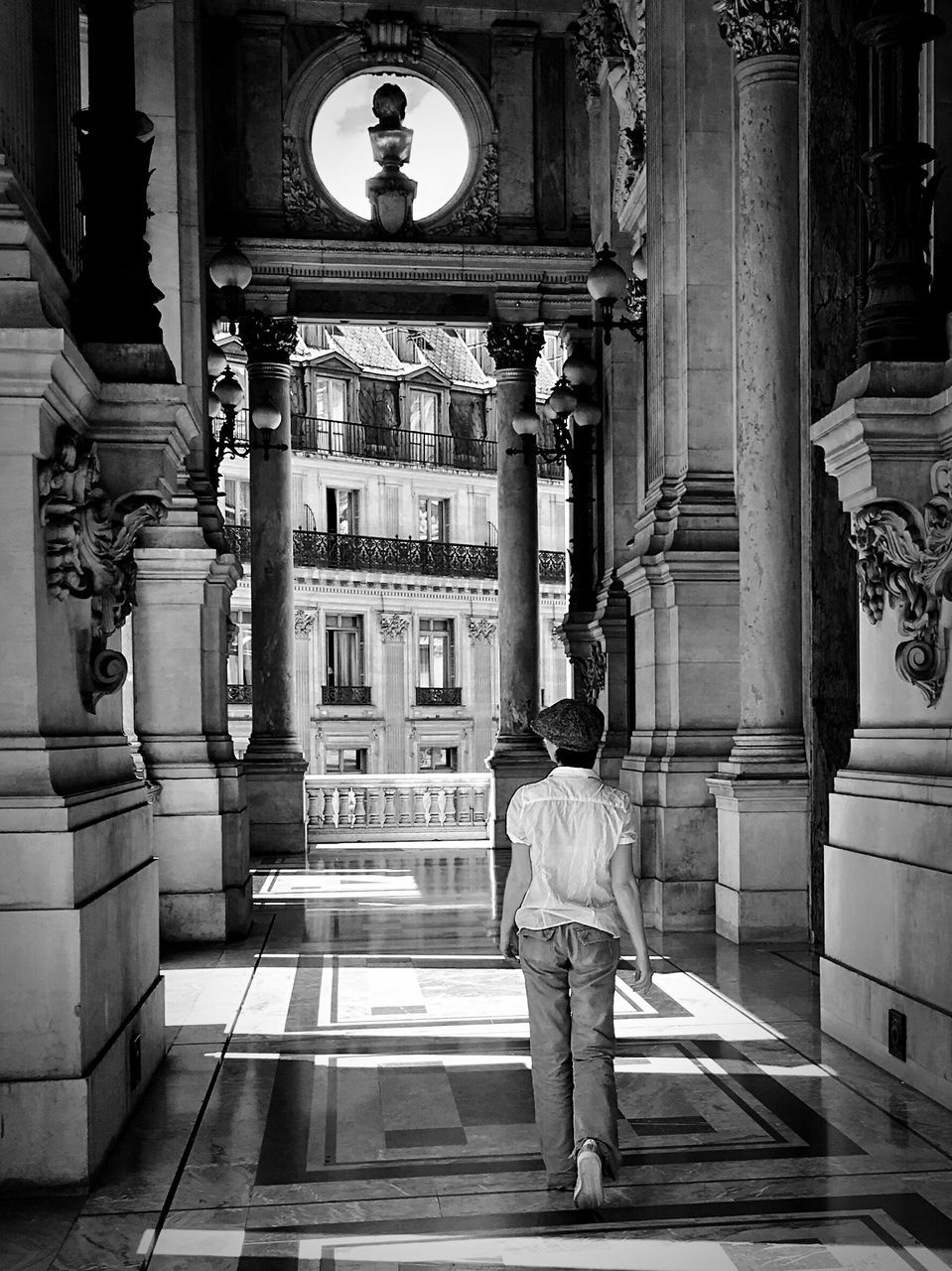 rear view, architecture, real people, built structure, full length, walking, one person, building exterior, men, illuminated, indoors, day, people