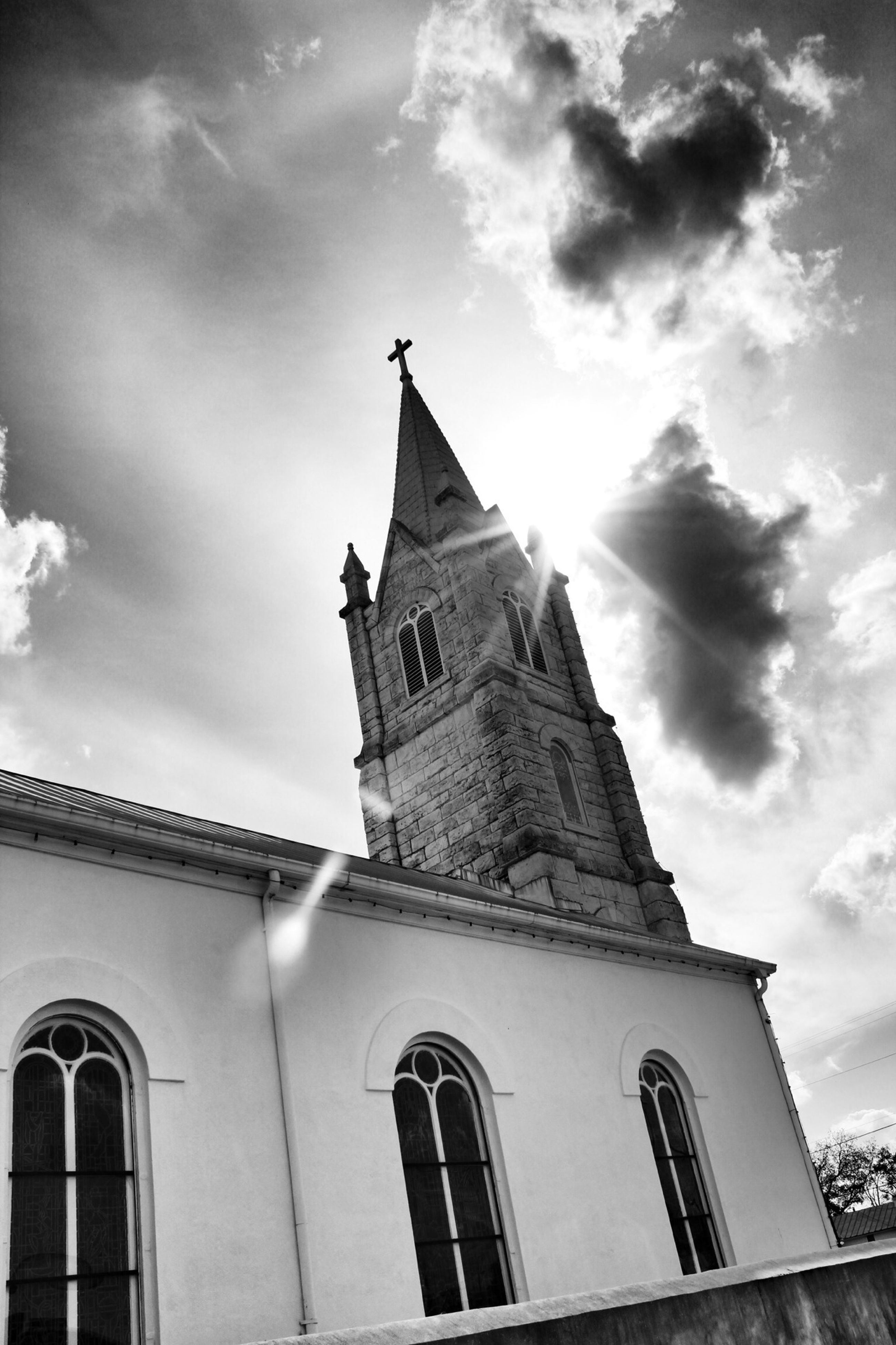 architecture, building exterior, built structure, low angle view, sky, cloud - sky, cloud, window, religion, cloudy, church, city, place of worship, tower, day, outdoors, high section, history, no people