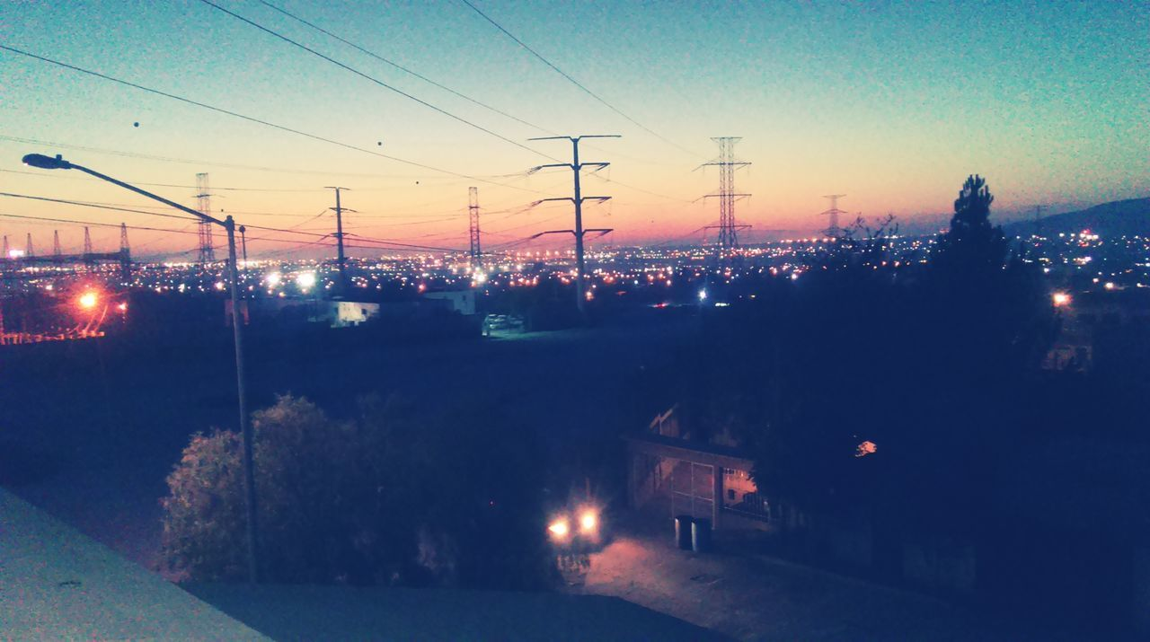 Electricity Pylon Against Sky At Dusk