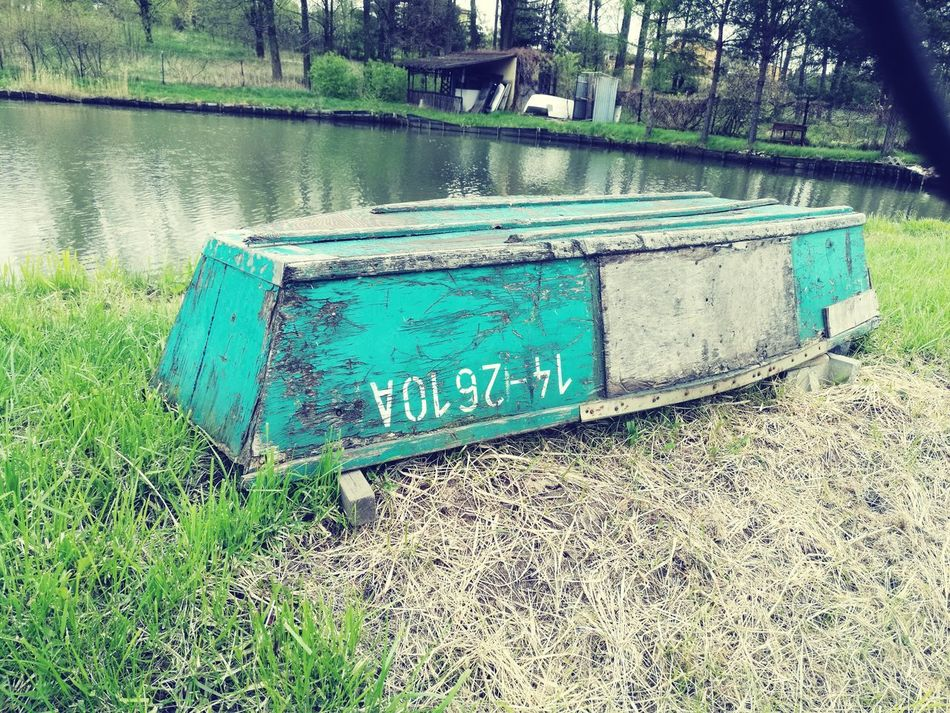 Text Day Water Outdoors No People Communication Grass Lake Nature Tree Old Boat