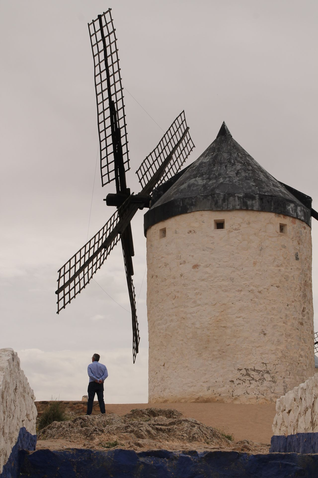 Wind Power Windmill Rural Scene Architecture Hanging Out Check This Out Travel Destinations La Mancha Consuegra Windmill Taking Photos Real People Built Structure Traditional Windmill Full Length Outdoors Standing Day Architecture Men One Person Sky Rear View Lifestyles Low Angle View