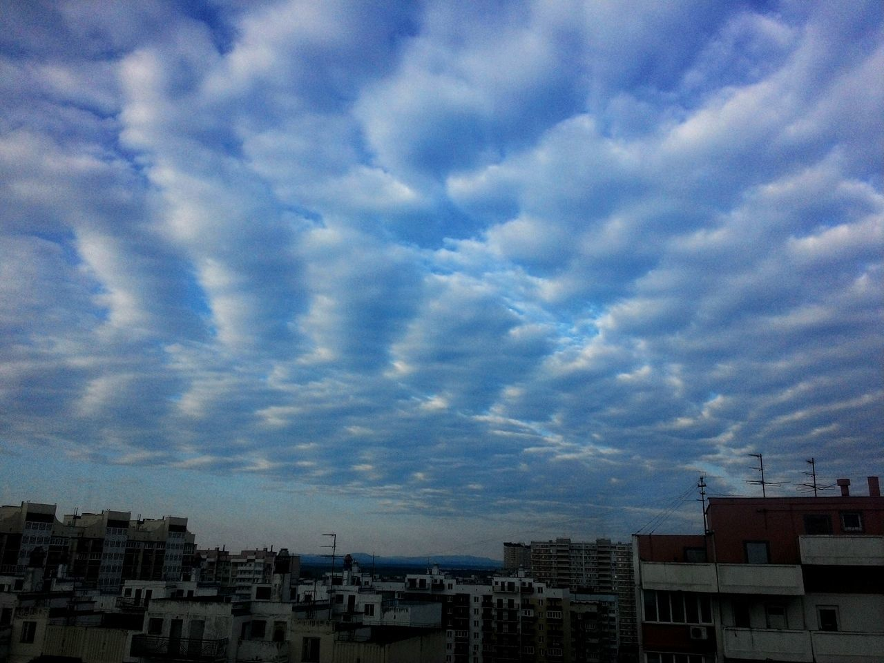 sky, architecture, building exterior, no people, cloud - sky, city, cityscape, built structure, residential, outdoors, nature, day