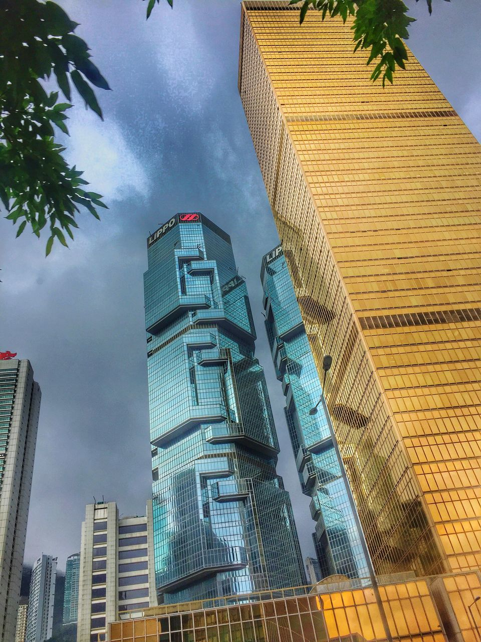 architecture, building exterior, built structure, low angle view, skyscraper, modern, sky, outdoors, no people, day, tall, city