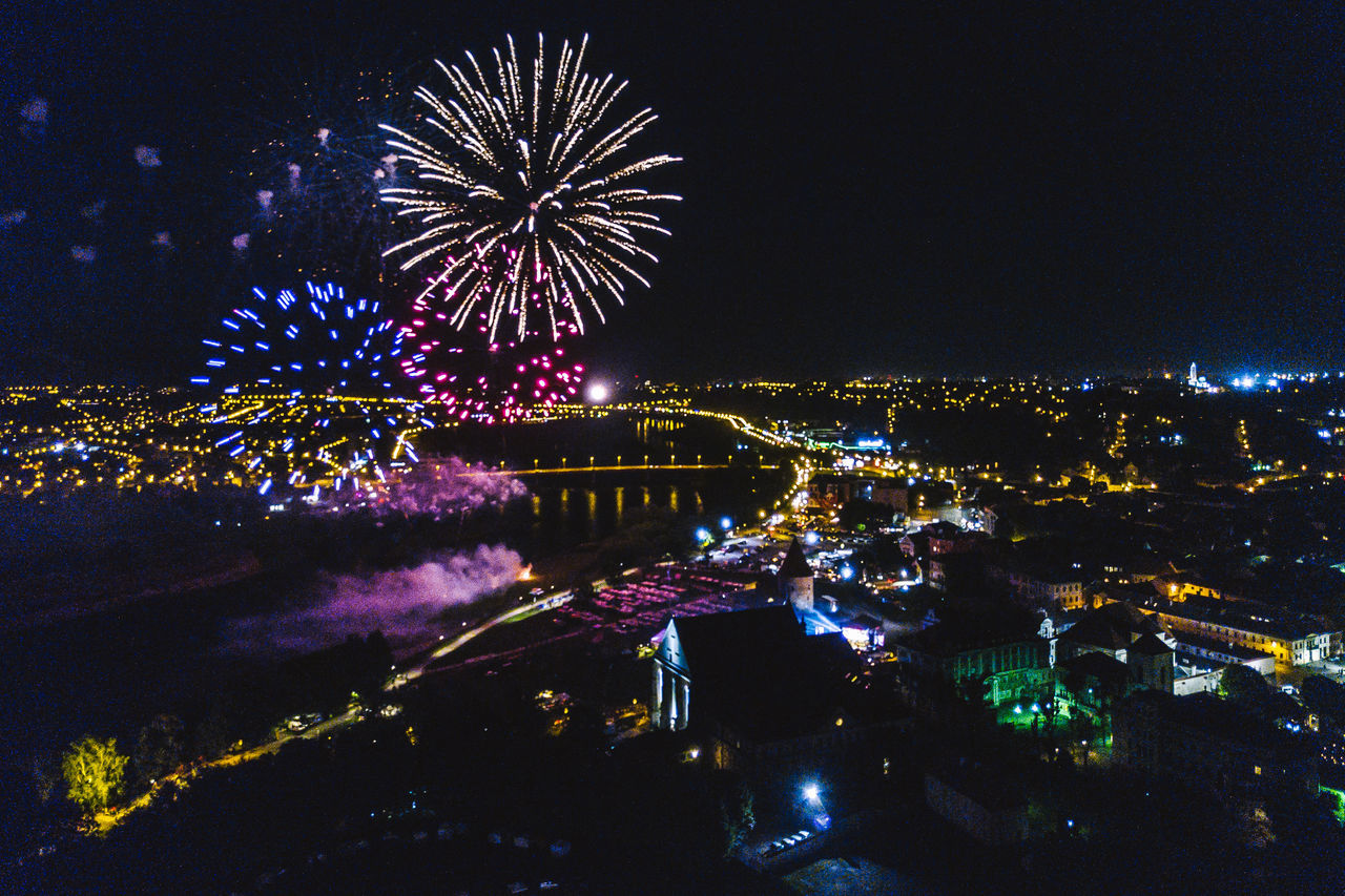Fireworks Architecture Arts Culture And Entertainment Building Exterior Built Structure Celebration City Cityscape Drone  Event Exploding Firework - Man Made Object Firework Display Illuminated Mavic Mavic Pro Multi Colored Night No People Outdoors Sky Water