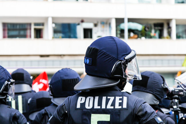 Police / captured in Frankfurt Blue Casual Clothing City City Life Day Focus On Foreground Head And Shoulders Helmet Leisure Activity Lifestyles Men Outdoors Pivotal Ideas Police Policeman Polizei Protest Protesters Selective Focus Urban