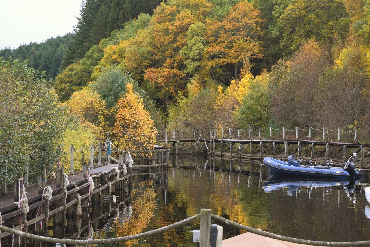 Docked in the scenery Tree Nature No People Water Day Growth Tranquility Outdoors Beauty In Nature Tranquil Scene Scenics Sky Architecture Willow Tree Scotlandsbeauty Autumn🍁🍁🍁 Scotland Mountain Loch  Loch Tay