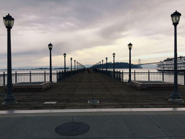 Symmetry... Symmetry Sanfrancisco Ferry Ferrybuilding Clouds Bridge Streetlamps Ocean Boardwalk