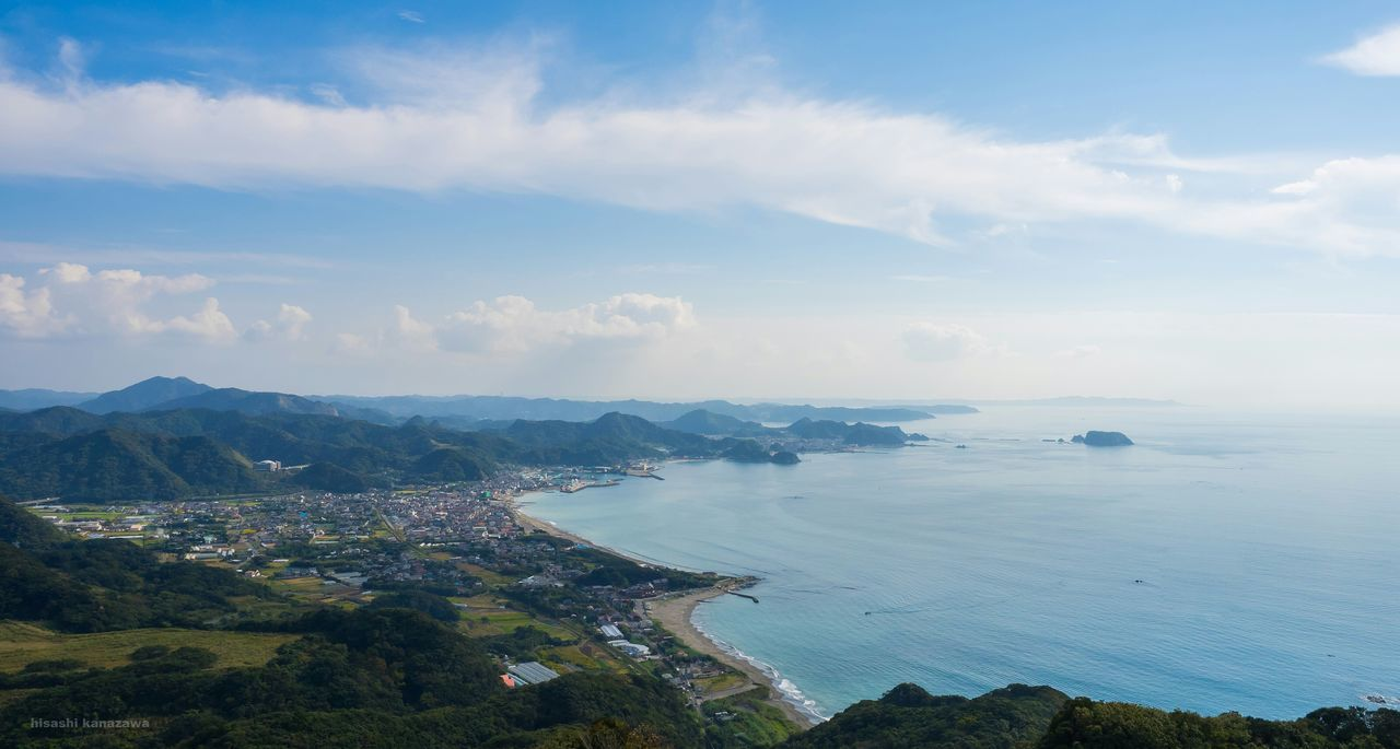 scenics, sky, beauty in nature, sea, nature, cloud - sky, water, high angle view, outdoors, no people, tranquility, tranquil scene, landscape, day, aerial view, mountain, cityscape