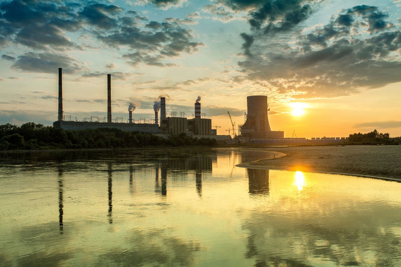 Power Stations Architecture Beauty In Nature Built Structure City Cityscape Cloud Cloud - Sky Idyllic Nature No People Orange Color Outdoors Reflection Rippled River Scenics Sky Sun Sunset Tall - High Tranquil Scene Tranquility Water Waterfront