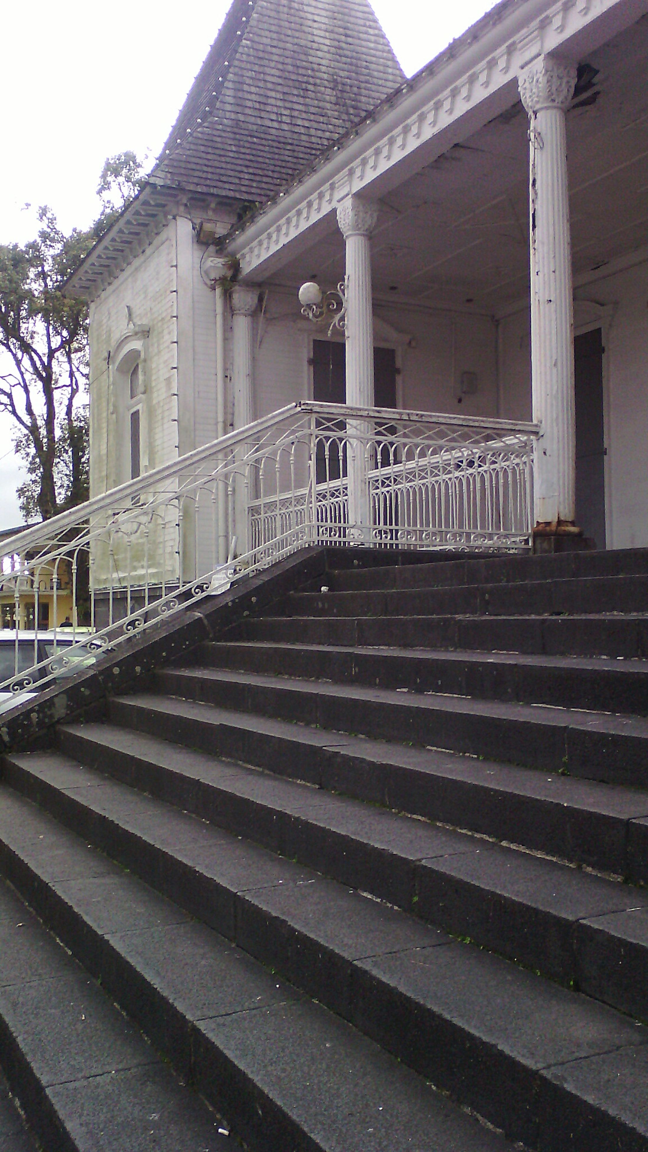 architecture, built structure, steps, building exterior, steps and staircases, religion, low angle view, spirituality, staircase, place of worship, travel destinations, railing, architectural column, sky, outdoors, day, history, famous place, city life, the way forward