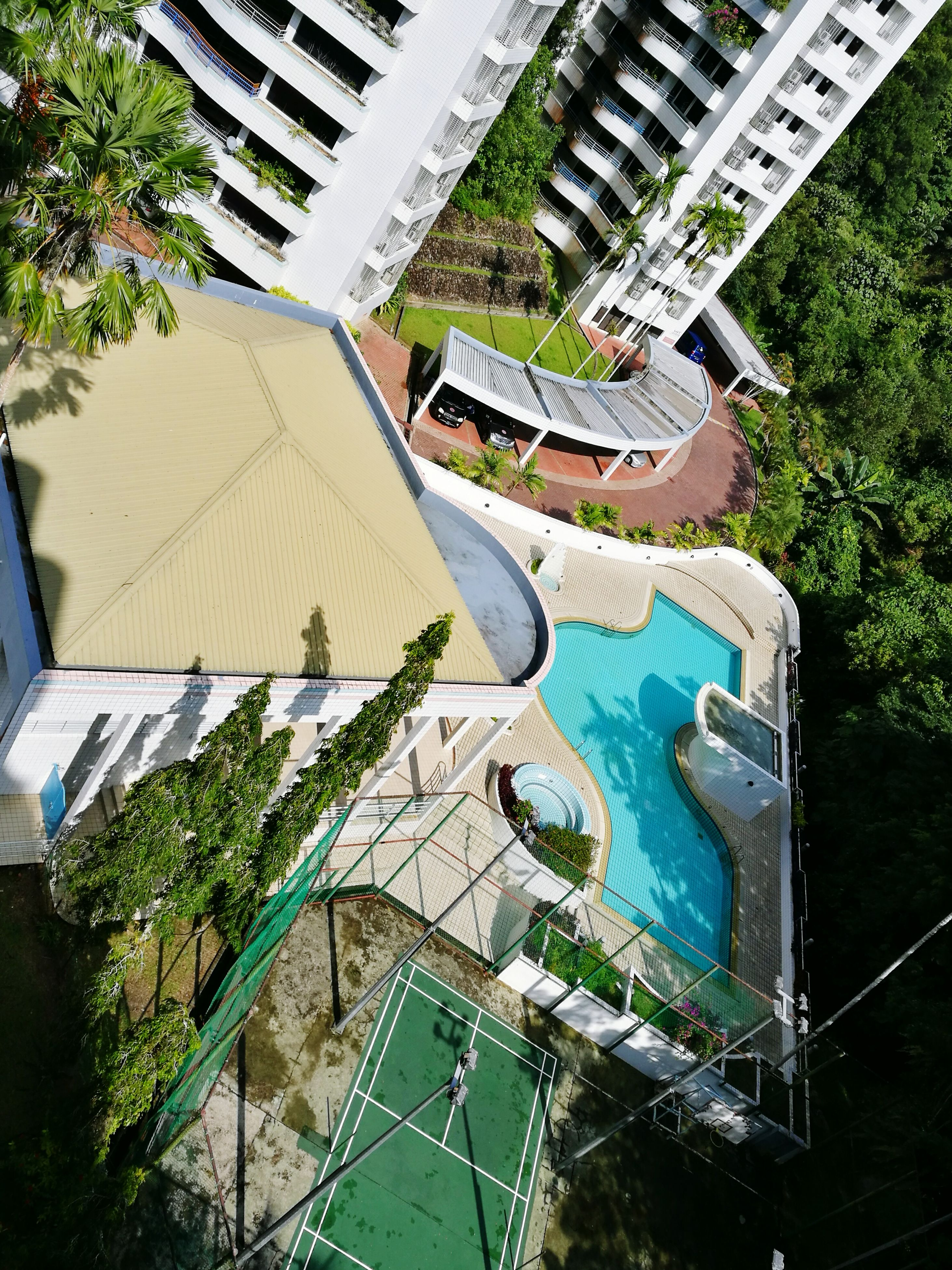 building exterior, architecture, built structure, swimming pool, high angle view, outdoors, water, tree, day, no people, skateboard park, city