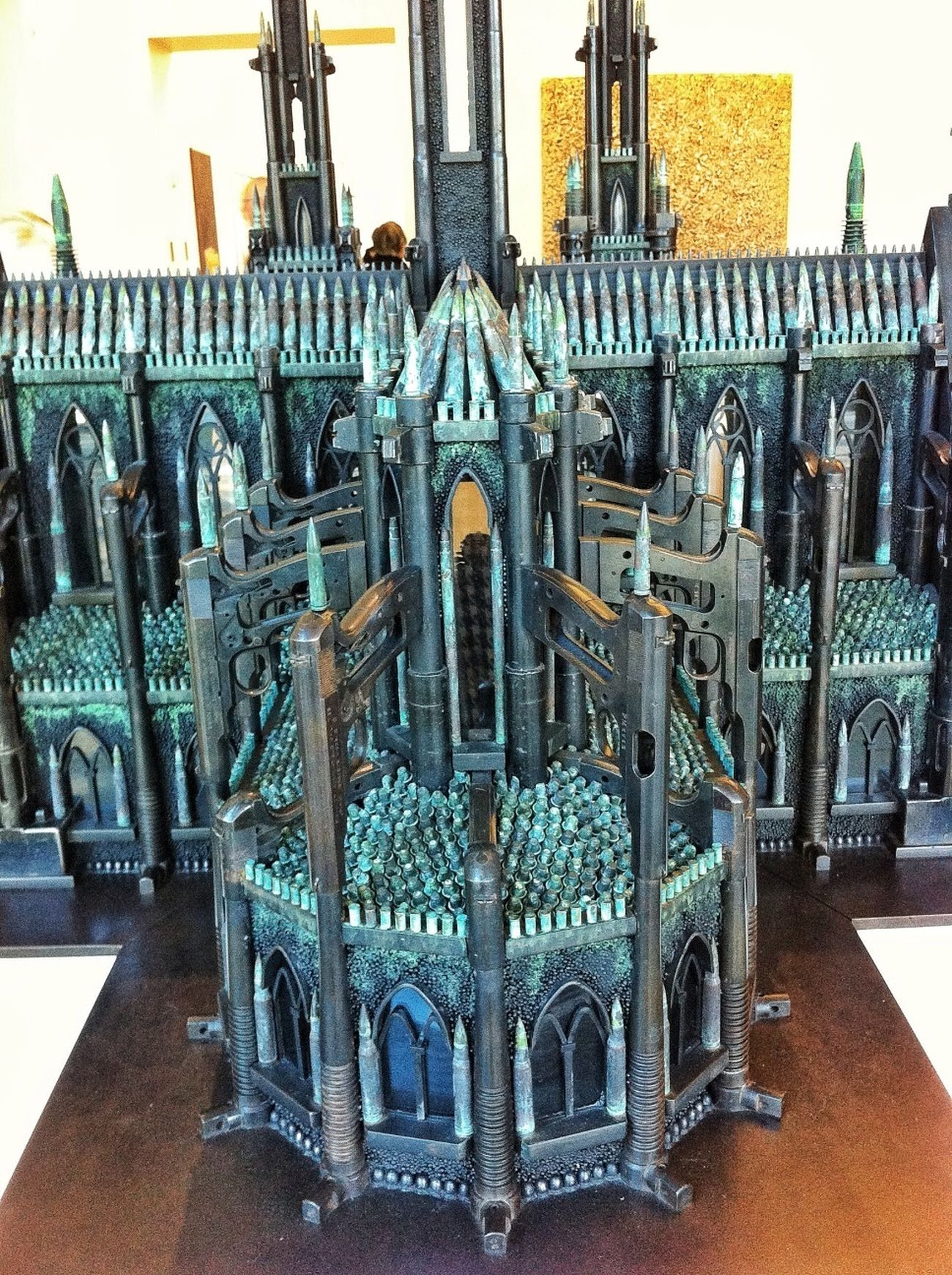 Cathedral made of guns and bullets sculpture