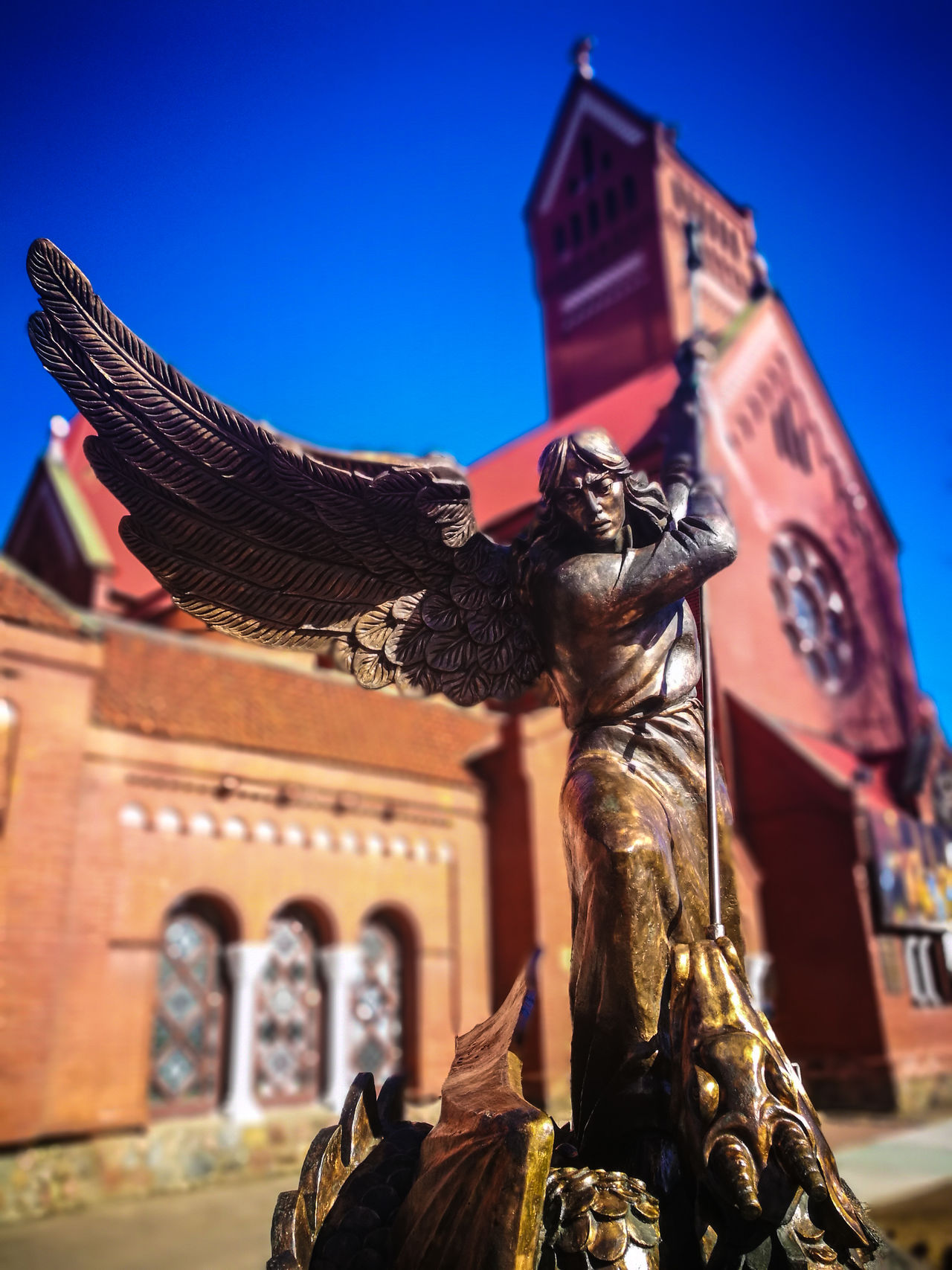 Angel Archangel Archangel Michael Architecture Belarus Blue Blurred Background Building Exterior Built Structure City Clear Sky Day Focus On Foreground History Horse HuaweiP9 Human Representation Male Likeness Minsk No People Outdoors Sculpture Sky Statue Travel Destinations