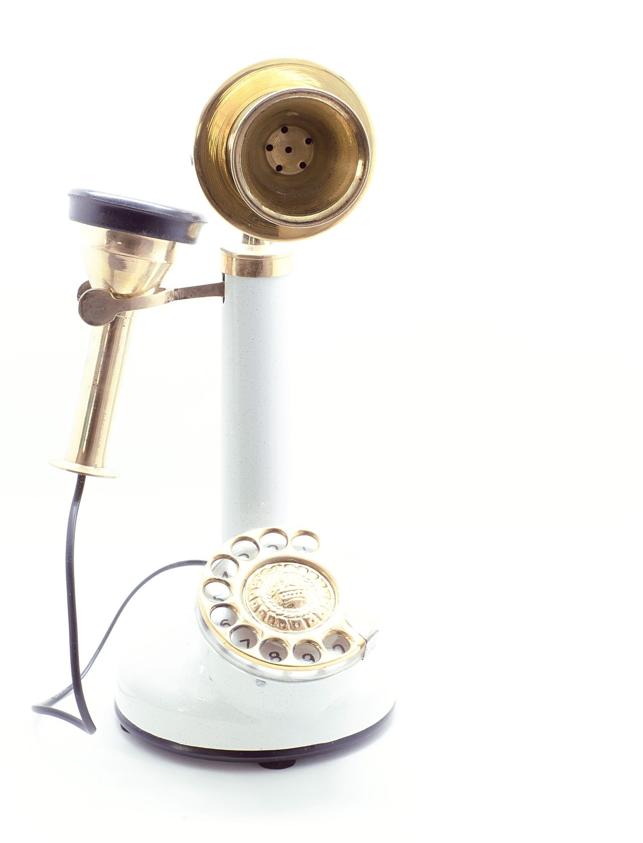 1900's Antique Brass candlesrick telephone 1900s Antique Brass Candlestick Telephone Oldest Machine Part White Background No People Old-fashioned Technology Close-up