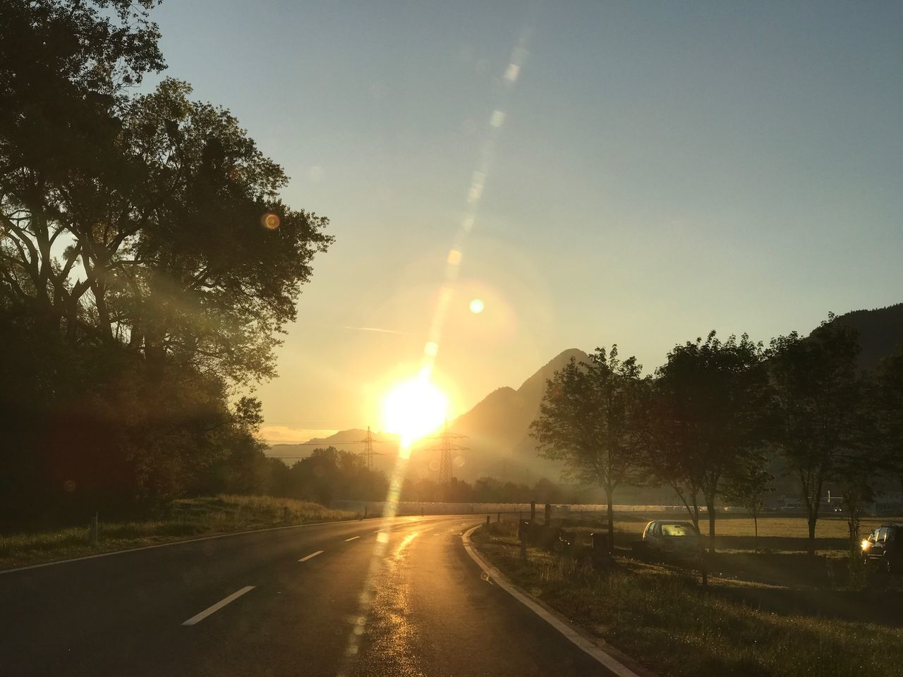 Sun Lens Flare Sunlight Sunbeam Sunset Road Tree Transportation The Way Forward No People Nature Outdoors Silhouette Beauty In Nature Scenics Sky Day