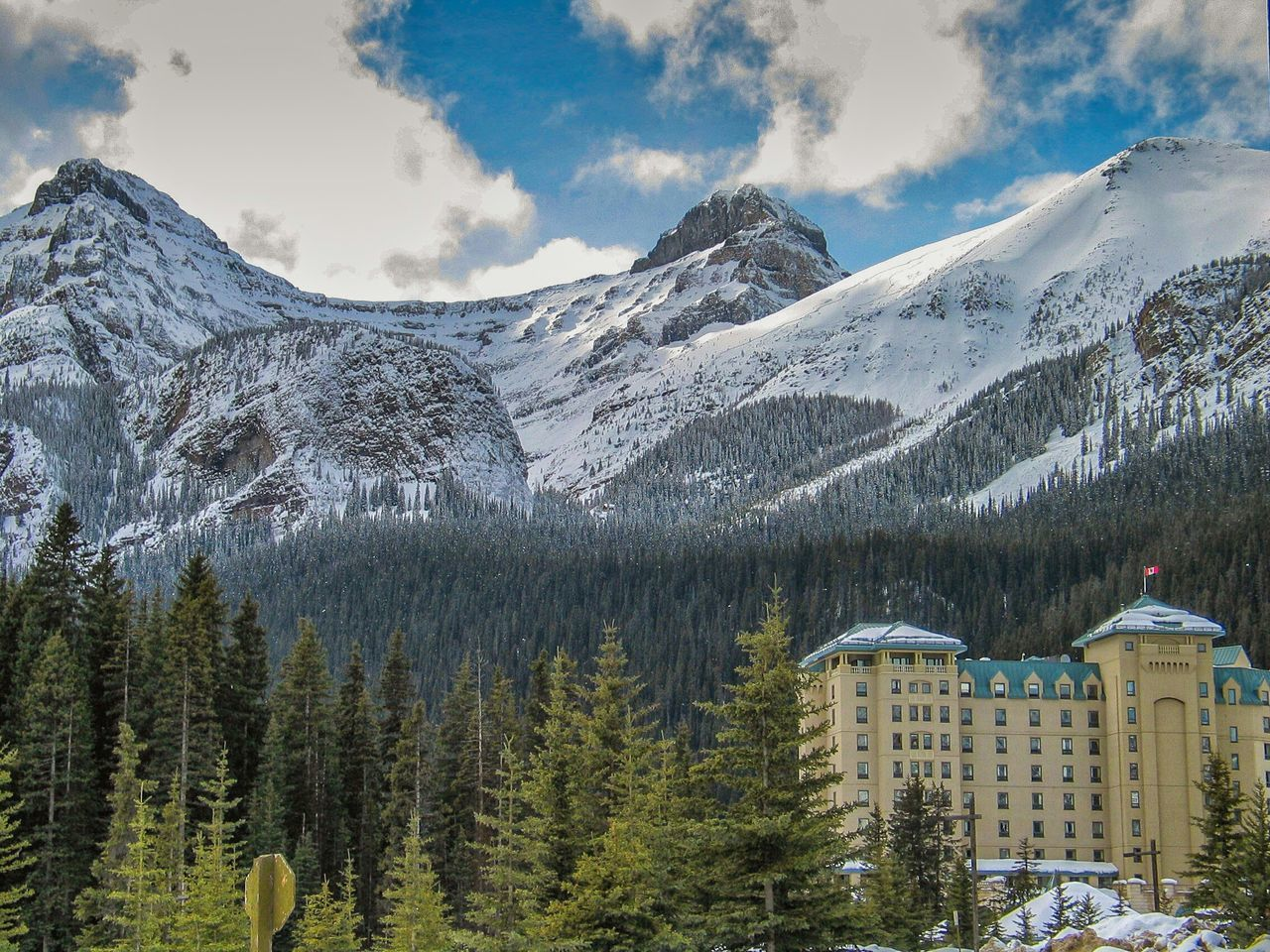 View Of Hotel With Snowcapped Mountain In Background