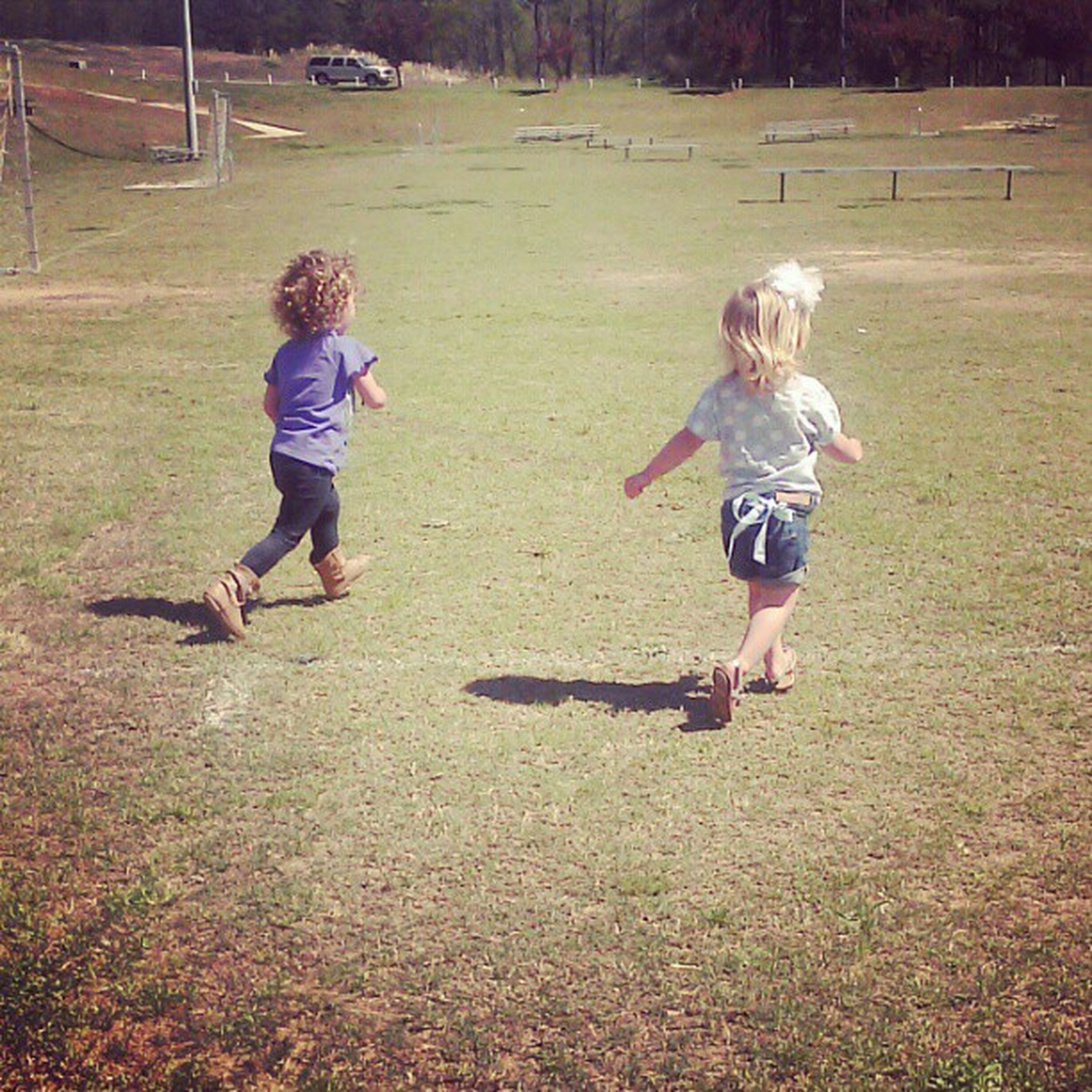 childhood, full length, elementary age, casual clothing, boys, lifestyles, girls, leisure activity, grass, innocence, person, playing, field, playful, cute, day, fun, park - man made space
