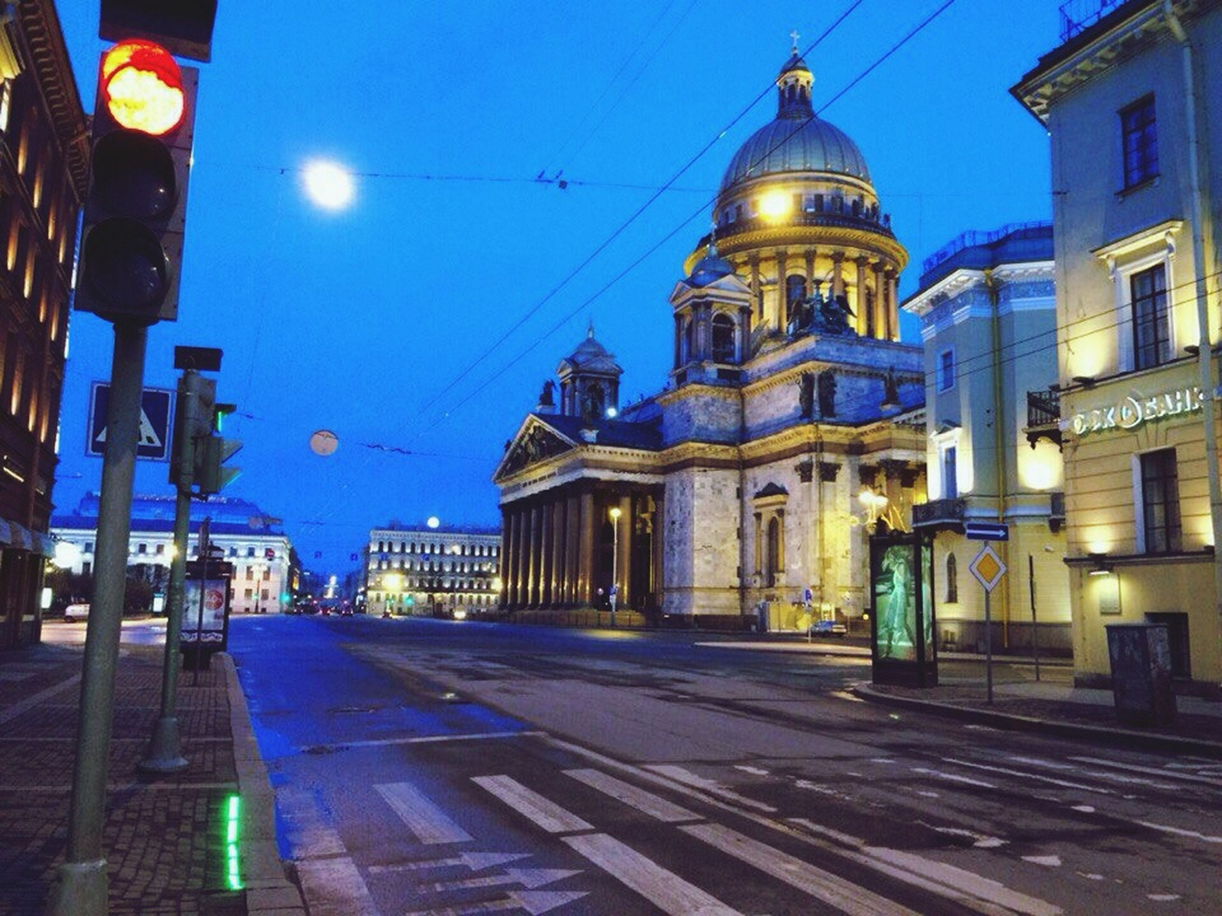 building exterior, architecture, built structure, illuminated, street light, religion, place of worship, church, night, blue, lighting equipment, spirituality, city, street, sky, travel destinations, dome, the way forward, cathedral