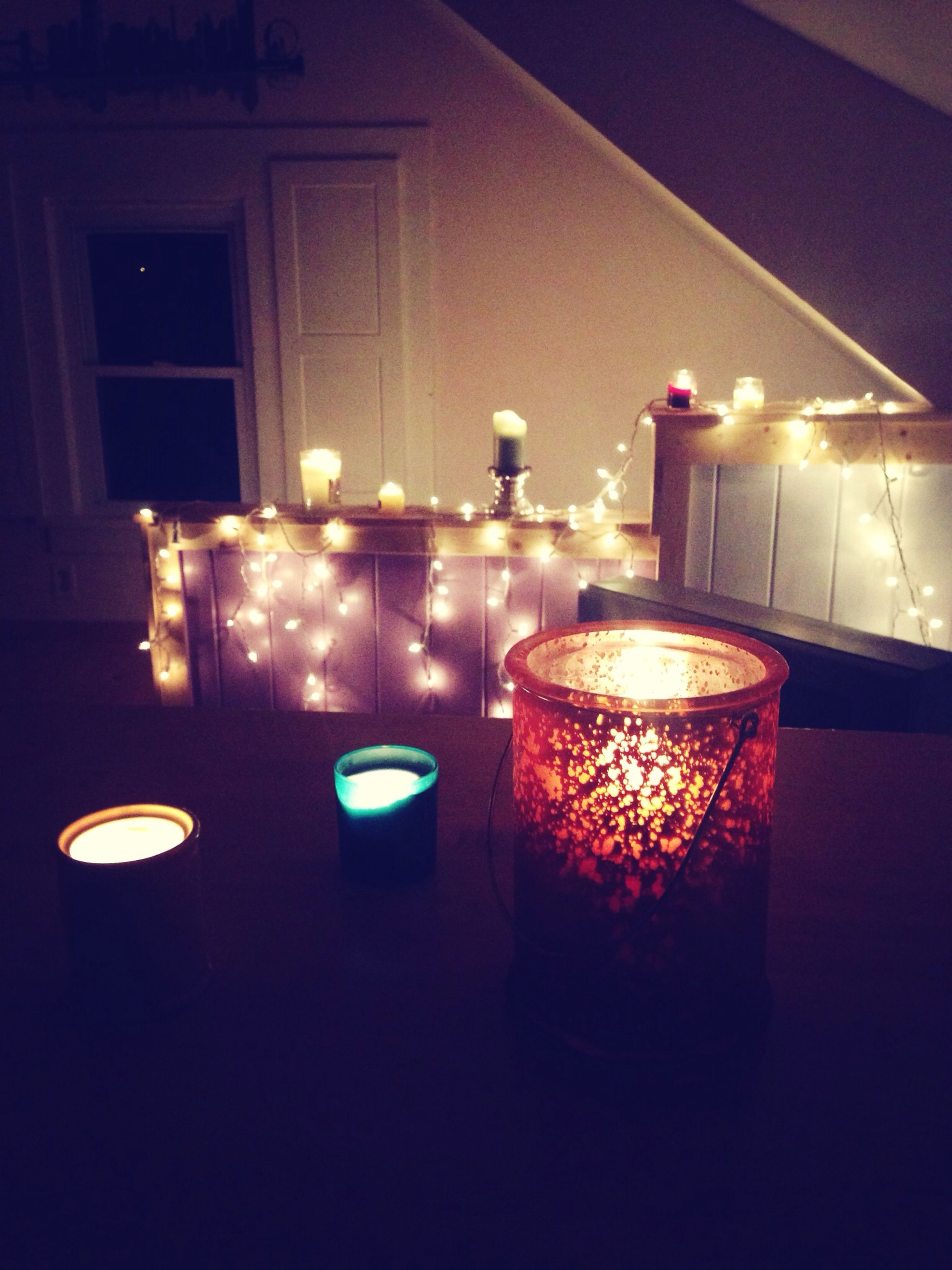 illuminated, indoors, candle, flame, burning, lit, glowing, table, lighting equipment, fire - natural phenomenon, heat - temperature, night, home interior, glass - material, candlelight, light - natural phenomenon, dark, still life, electric lamp, no people