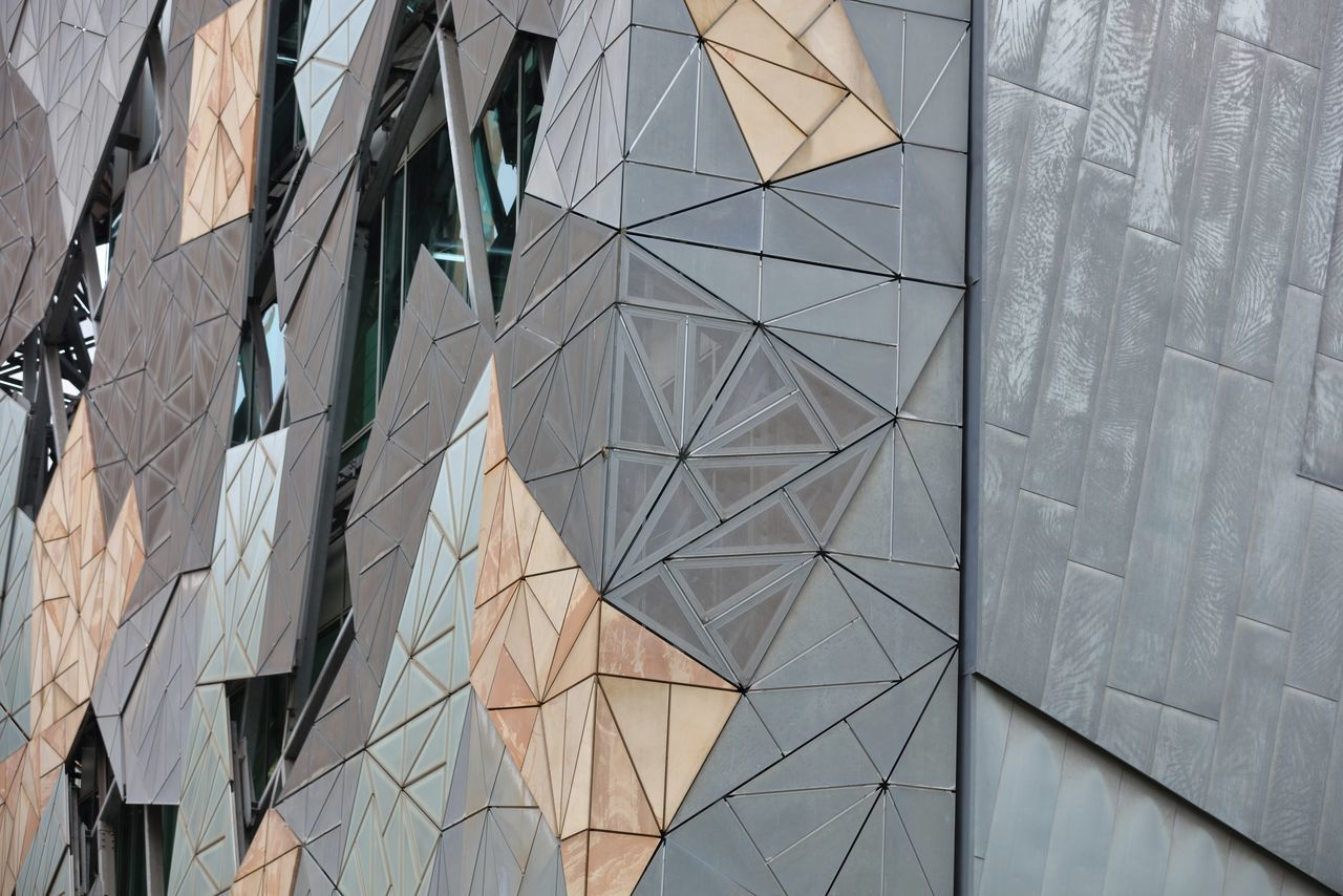 A close up capture, of a section, of the Melbourne Museum of Arts exterior structure. The flat rectangle panels had a fingerprint signature applied to each of the panels surfaces. As no two fingerprints are alike, to me, it implied that this unique piece of architecture had its own individual identity like no other. Abstract Photography Architecture Art Is Everywhere ArtWork Building Exterior Built Structure Complex Design Eye4photography  EyeEm EyeEm Best Shots EyeEm Gallery EyeEmNewHere Fingerprint Full Frame Full Frame Composition Glass - Material Looking Into Structure Low Angle View Melbourne City Modern Design Outdoors Tadaa Community The Architect - 2017 EyeEm Awards Triangles Visual Impact