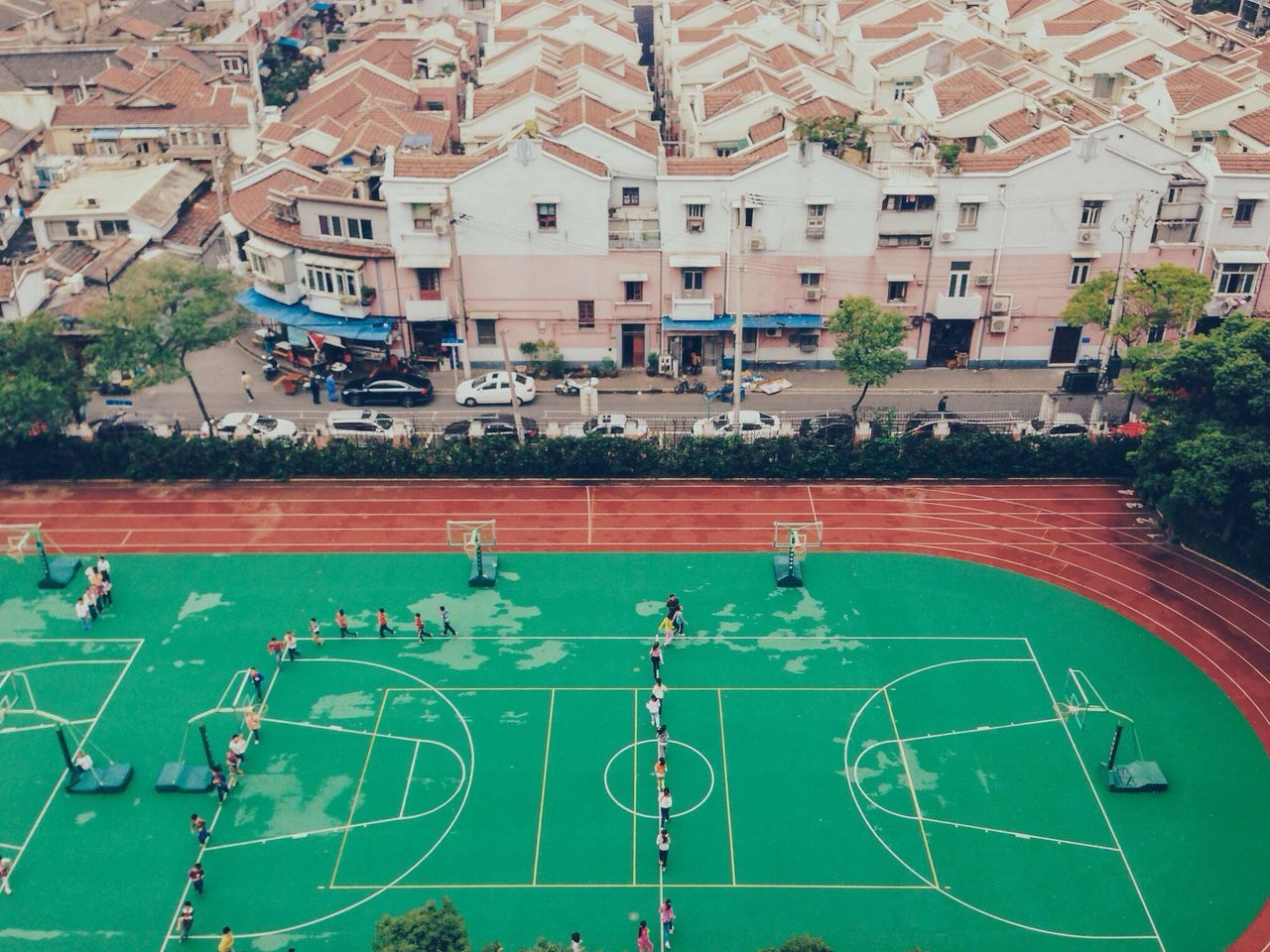 High angle view of school students running in basketball court
