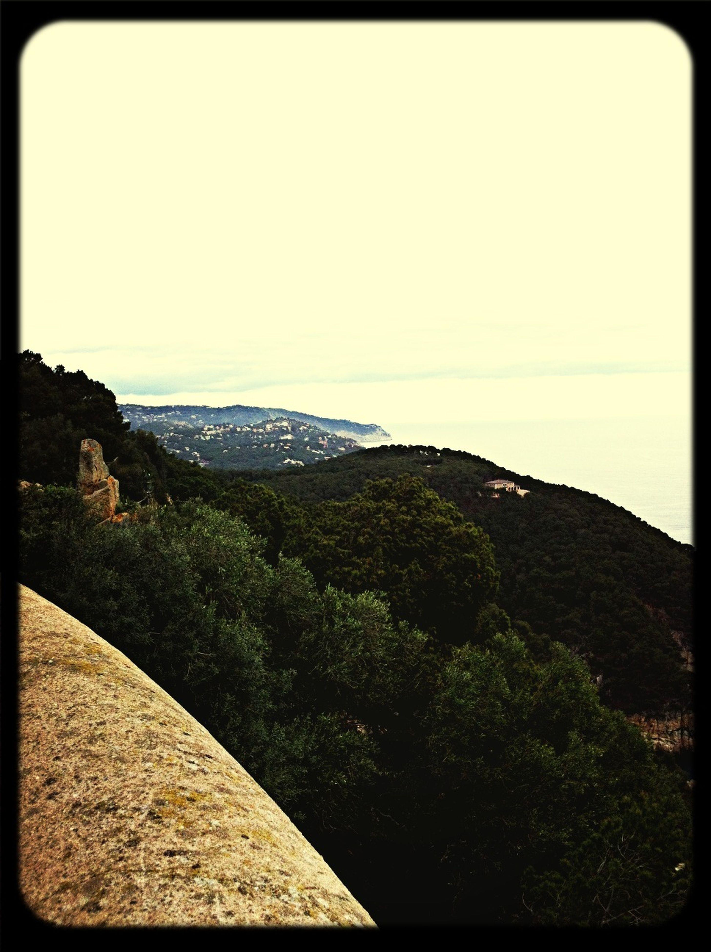 transfer print, mountain, auto post production filter, tranquil scene, tranquility, scenics, landscape, beauty in nature, clear sky, mountain range, nature, copy space, sky, non-urban scene, tree, hill, idyllic, non urban scene, remote, day