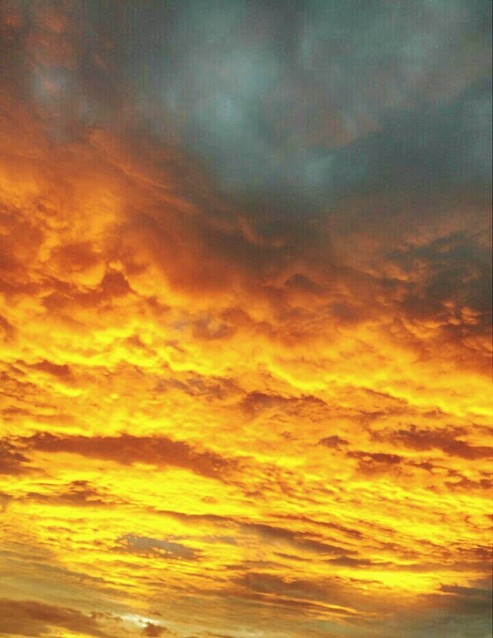 cloud - sky, sunset, dramatic sky, orange color, sky, nature, beauty in nature, scenics, backgrounds, yellow, dusk, no people, abstract, tranquil scene, night, sky only, outdoors, red, multi colored, space