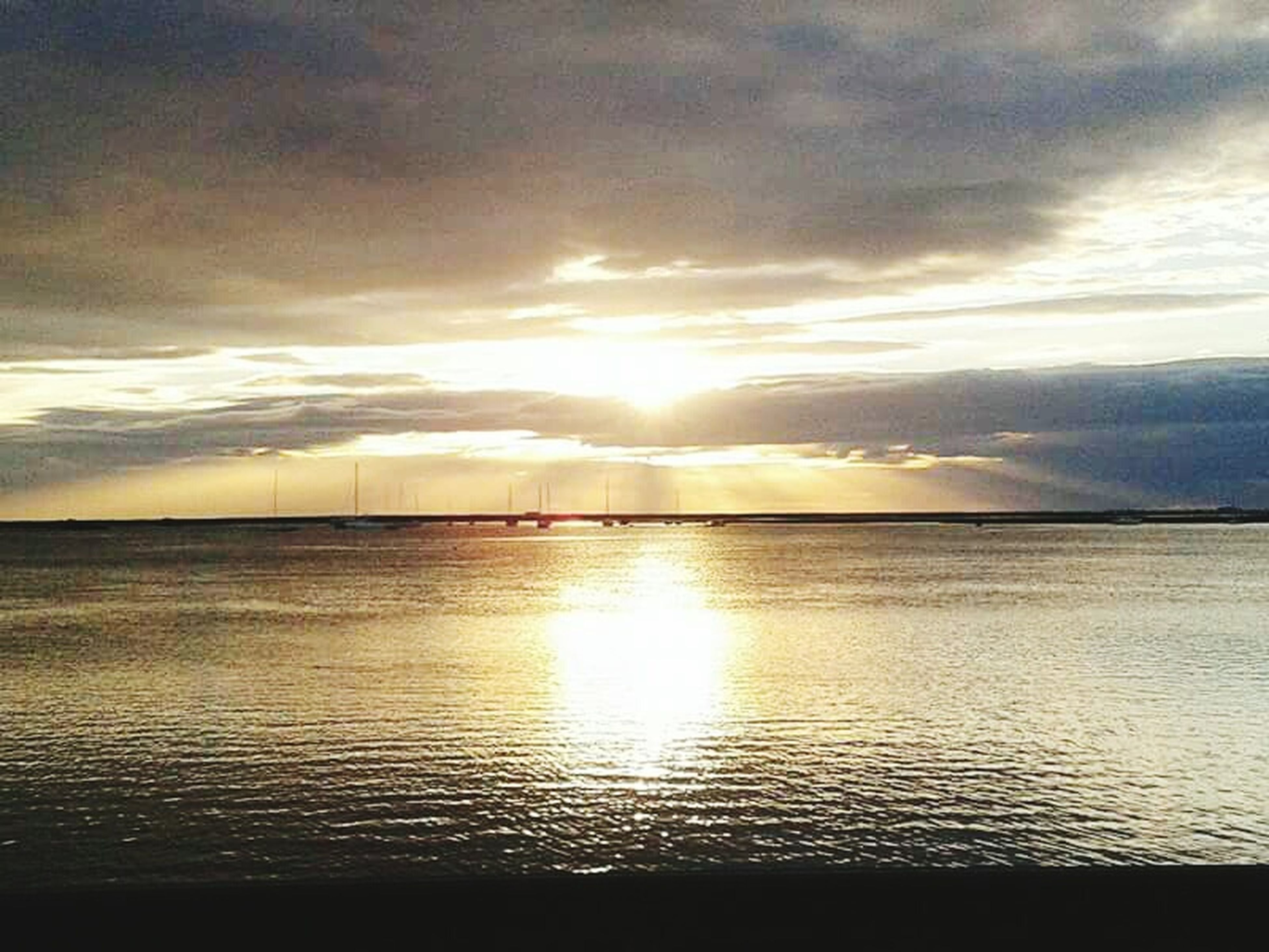 sunset, water, nature, beauty in nature, sea, tranquility, scenics, reflection, tranquil scene, sky, horizon over water, outdoors, beach, cloud - sky, no people, day
