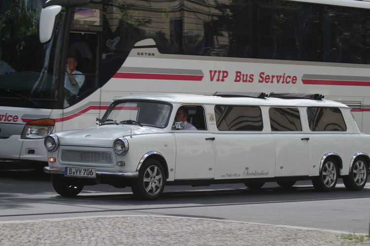 Bus Versus Limo Driving Joke Limousine Long Vehicle Luxury Transportation Outdoors Show Off Stretch Limo Stretch Trabbi Stretch Trabbi Limo