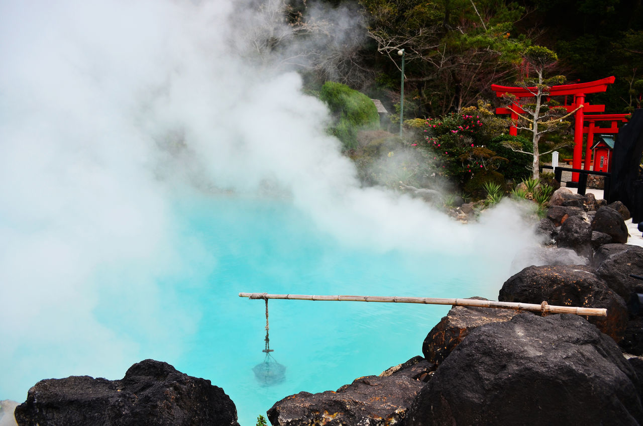 Umi Jigoku or Sea hell Beauty In Nature Day Hot Spring KYUSHU Motion Nature No People Onsen Outdoors Rock - Object Smoke - Physical Structure Tree Water